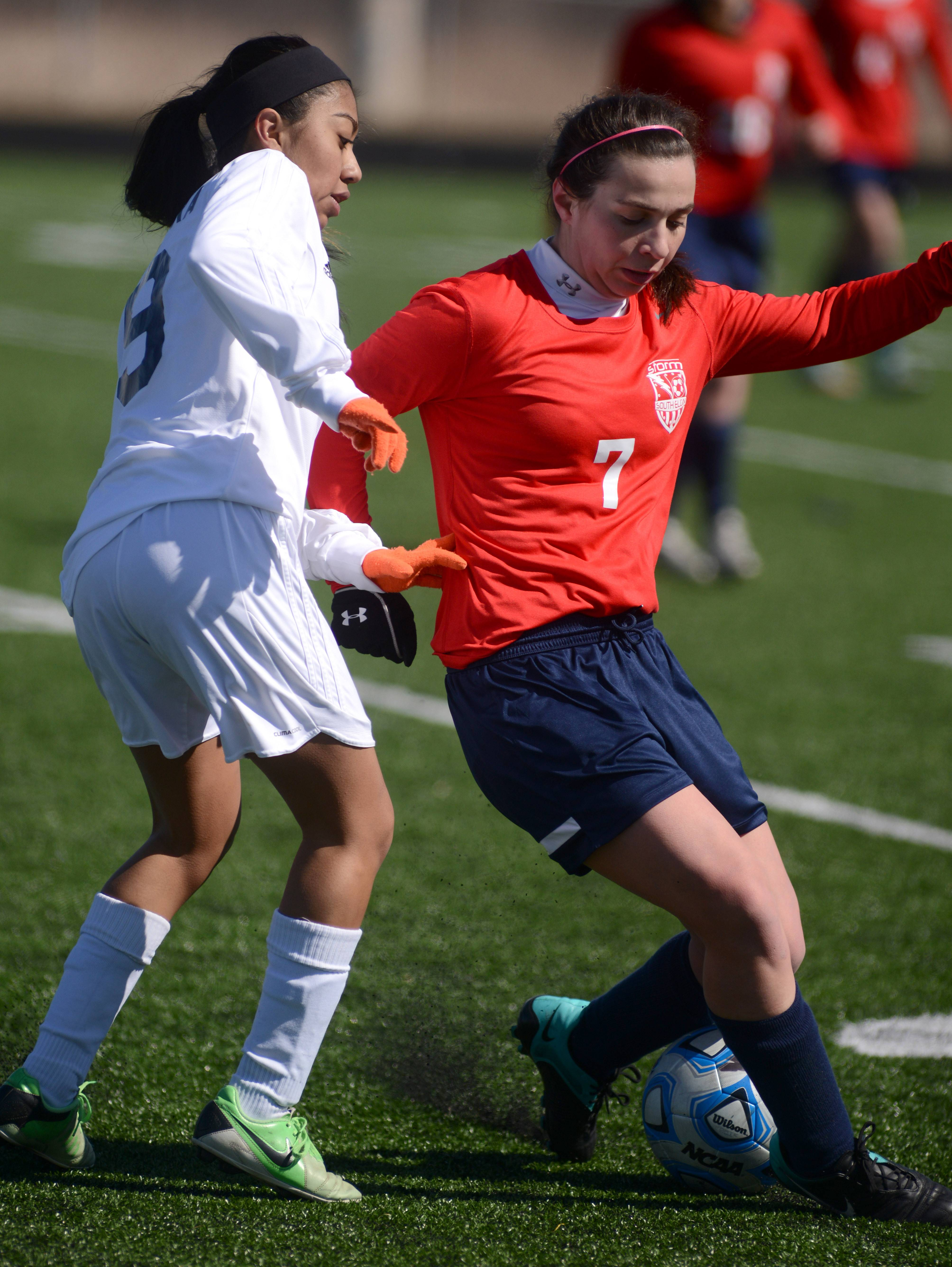 West Chicago's Karen Ibarra, left, and South Elgin's Melissa Greco battle for the ball in the first half of the championship game of the South Elgin tournament in Streamwood Friday.