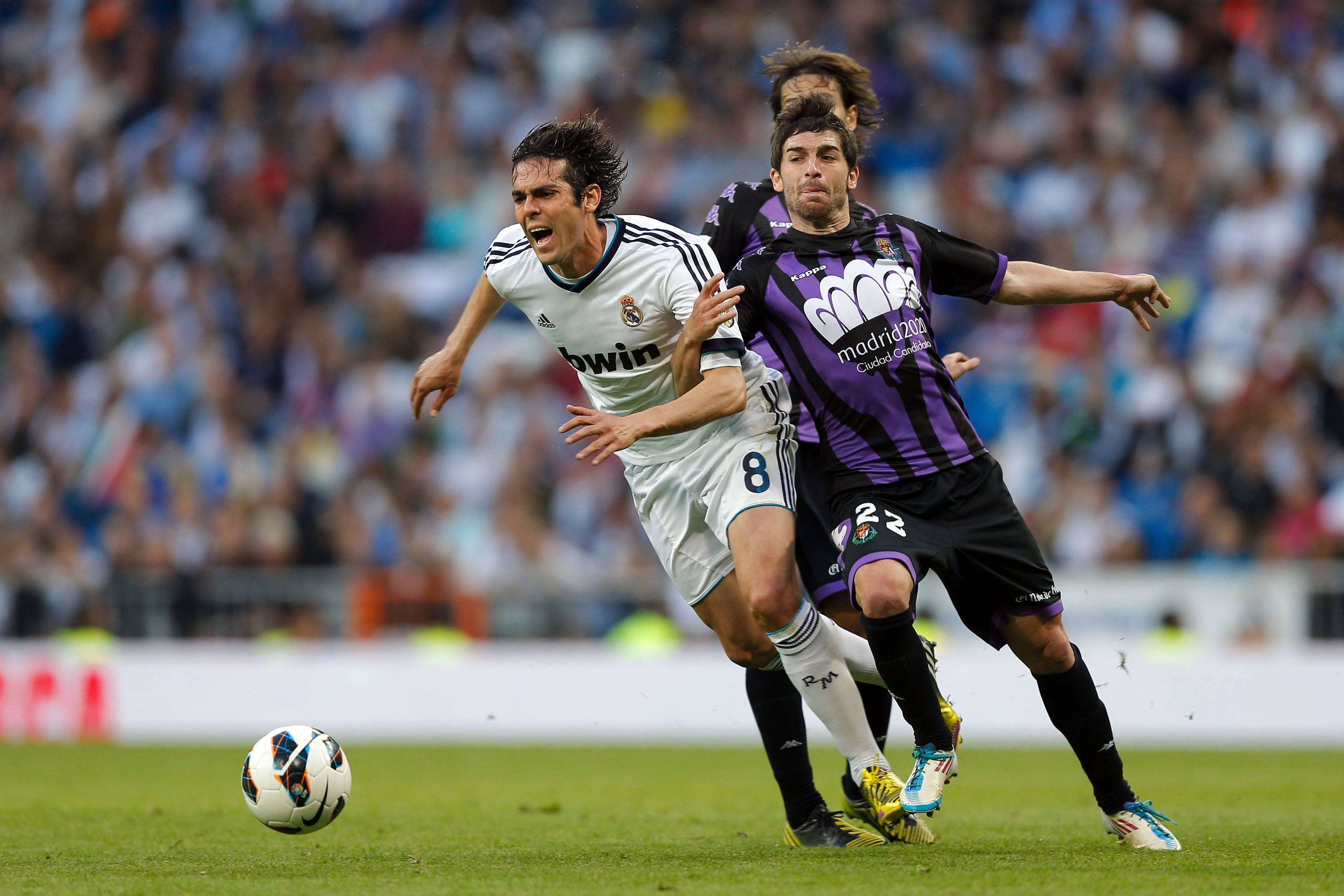Real Madrid's Kaka from Brazil, left, duels for the ball with Valladolid's Victor Perez in a Spanish La Liga match. The Chicago Fire has signed Perez, a midfielder, team officials said Friday.