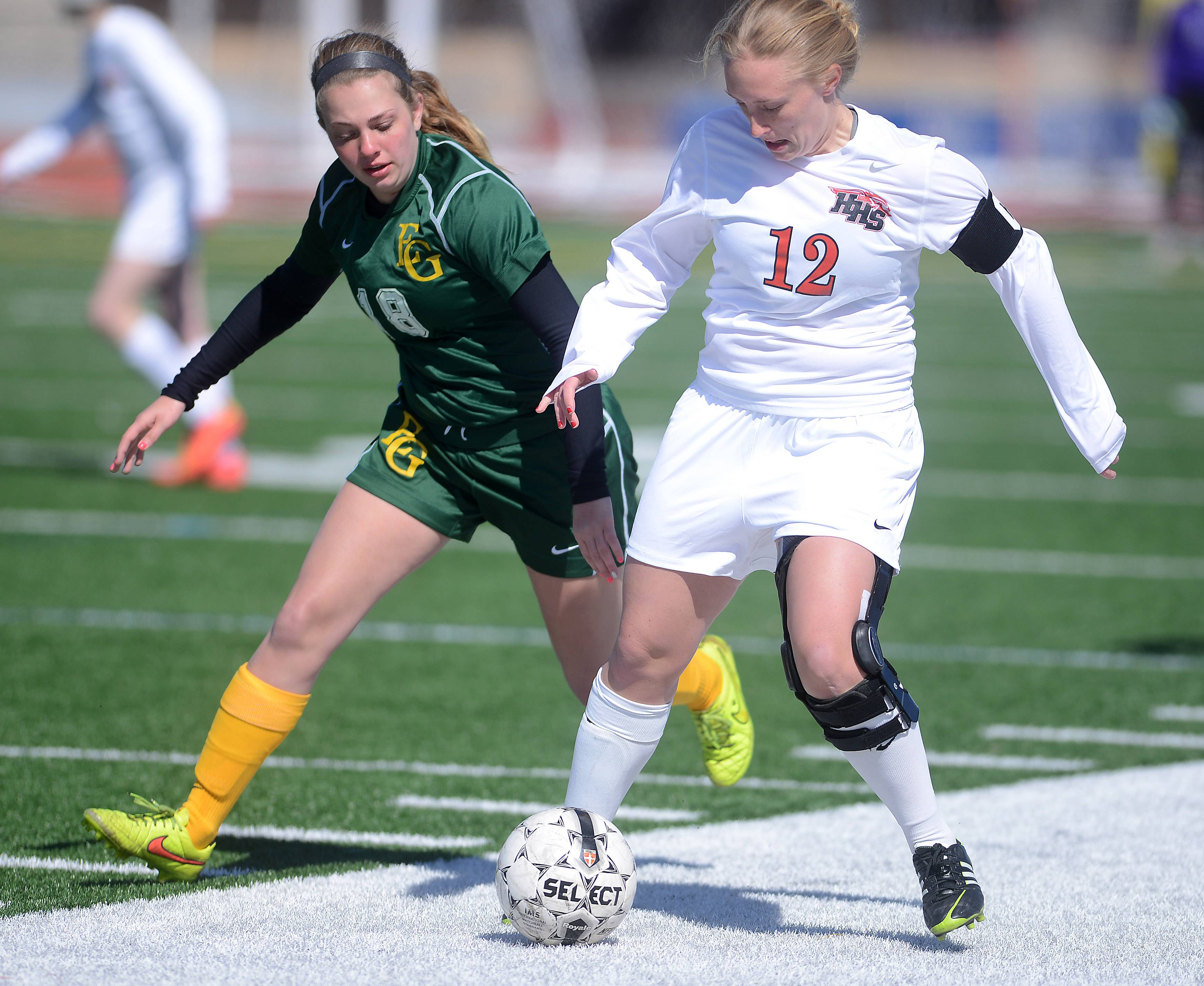 Huntley's Deanna Hecht brings the ball up the sideline as Elk Grove's Ally Czyzewski defends during Saturday's game in Huntley.