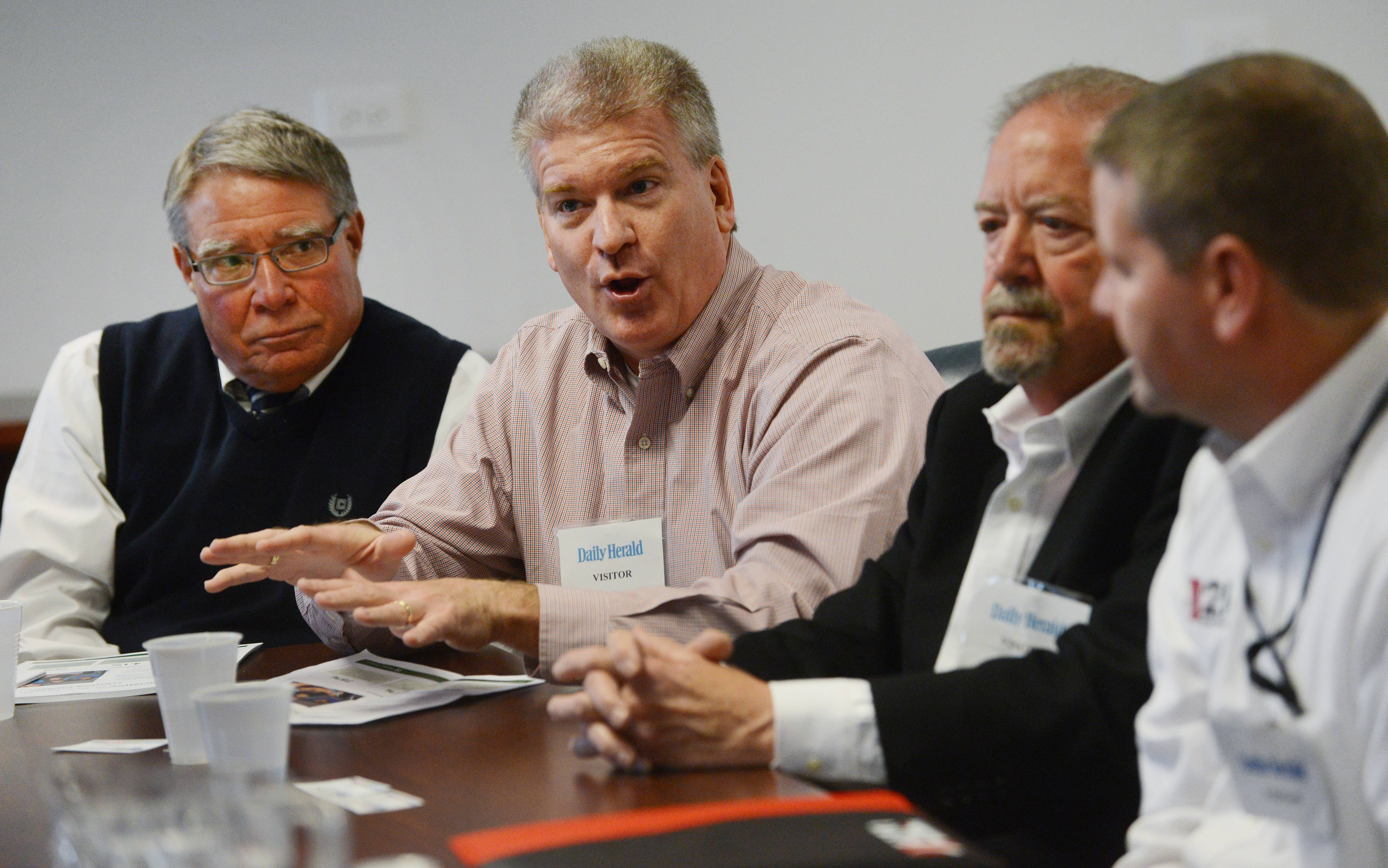 From left, Harper College President Ken Ender, Barrington Unit District 220 Superintendent Brian Harris, Michael Alagna, the former COO of Nation Pizza and Foods and Northwest Suburban High School District 214 Superintendent David Schuler helped design the Promise program.