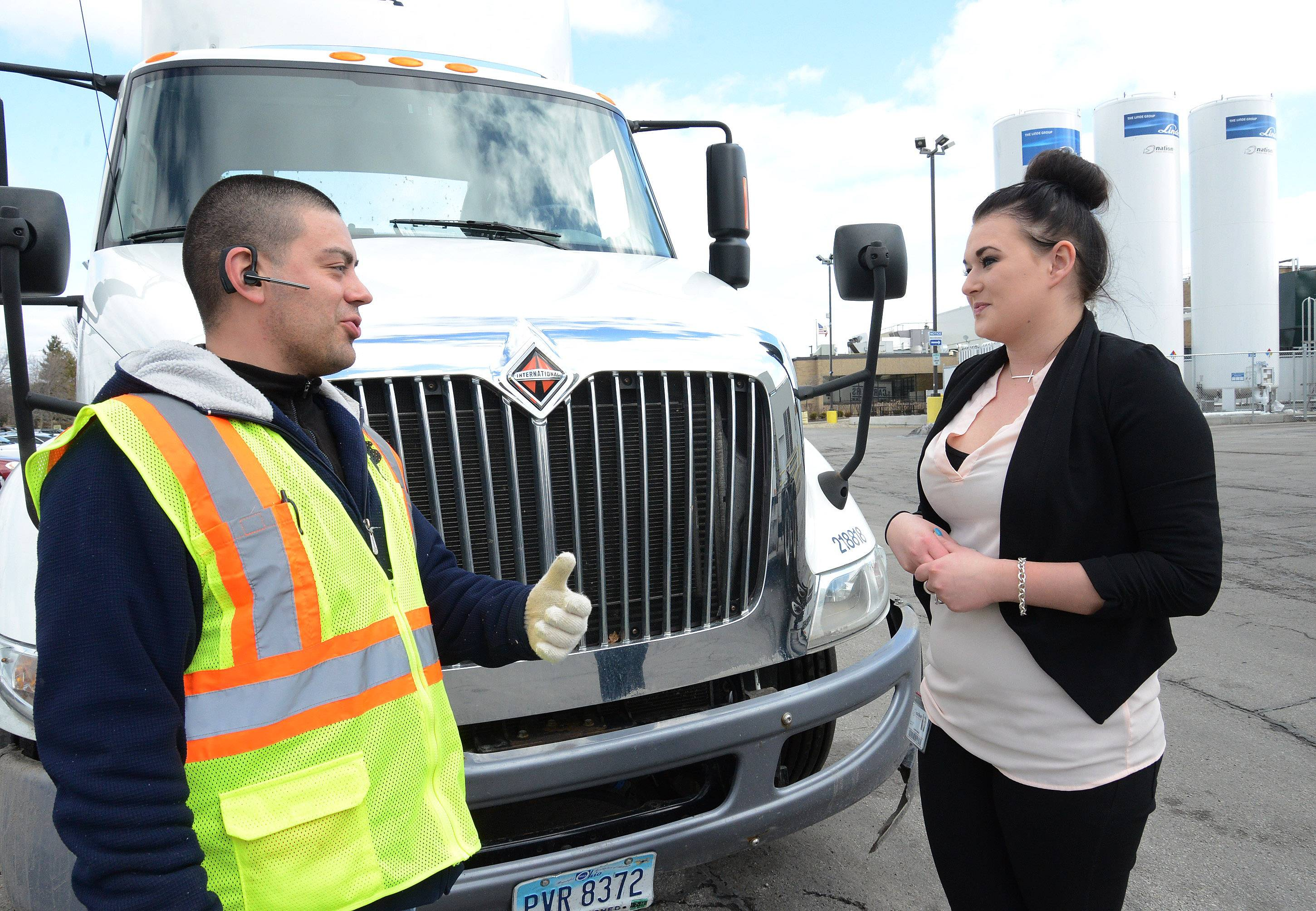 Nicole Kozodaj, with driver Brian Navas, earned a certificate in business management from Harper College and now works at Nation Pizza and Foods, a manufacturer with close ties to the Promise program.