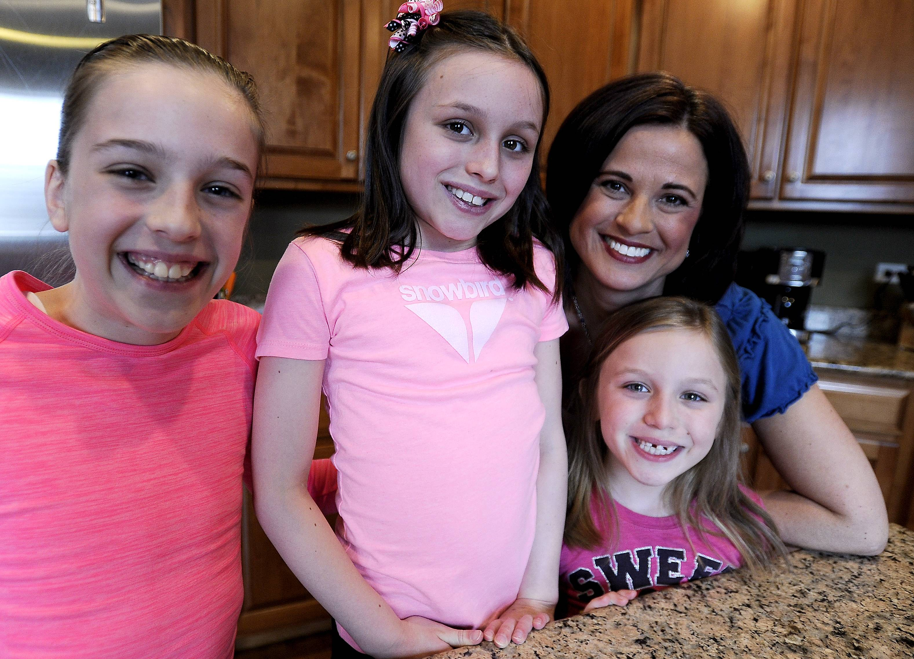 Lucca Teuscher, 8, (center) is surrounded by her sisters Cassidy, 10, and Macey, 7, and her mom Melissa, who does everything she can to protect her daughter from her life-threating peanut allergy.