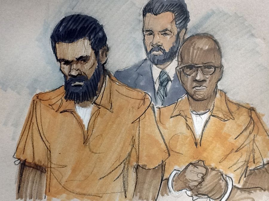 In this courtroom sketch, Jonas M. Edmonds, left, and Hasan R. Edmonds stand in front of an FBI agent at a federal court hearing March 26 in Chicago. Hasan Edmonds was back in court Monday.