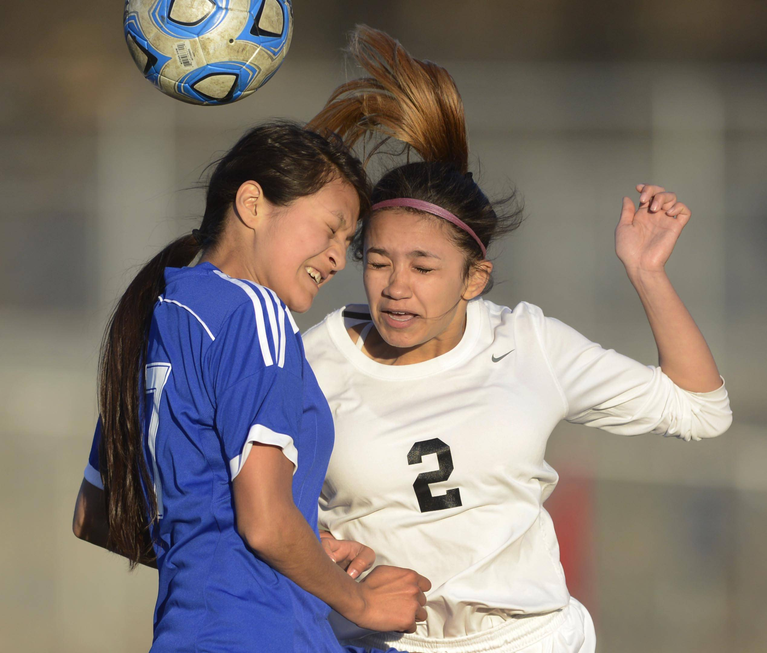 Elgin's Yulissa Gutierrez and Larkin's Stephanie Nunez, left, compete for a header Tuesday at Memorial Field.