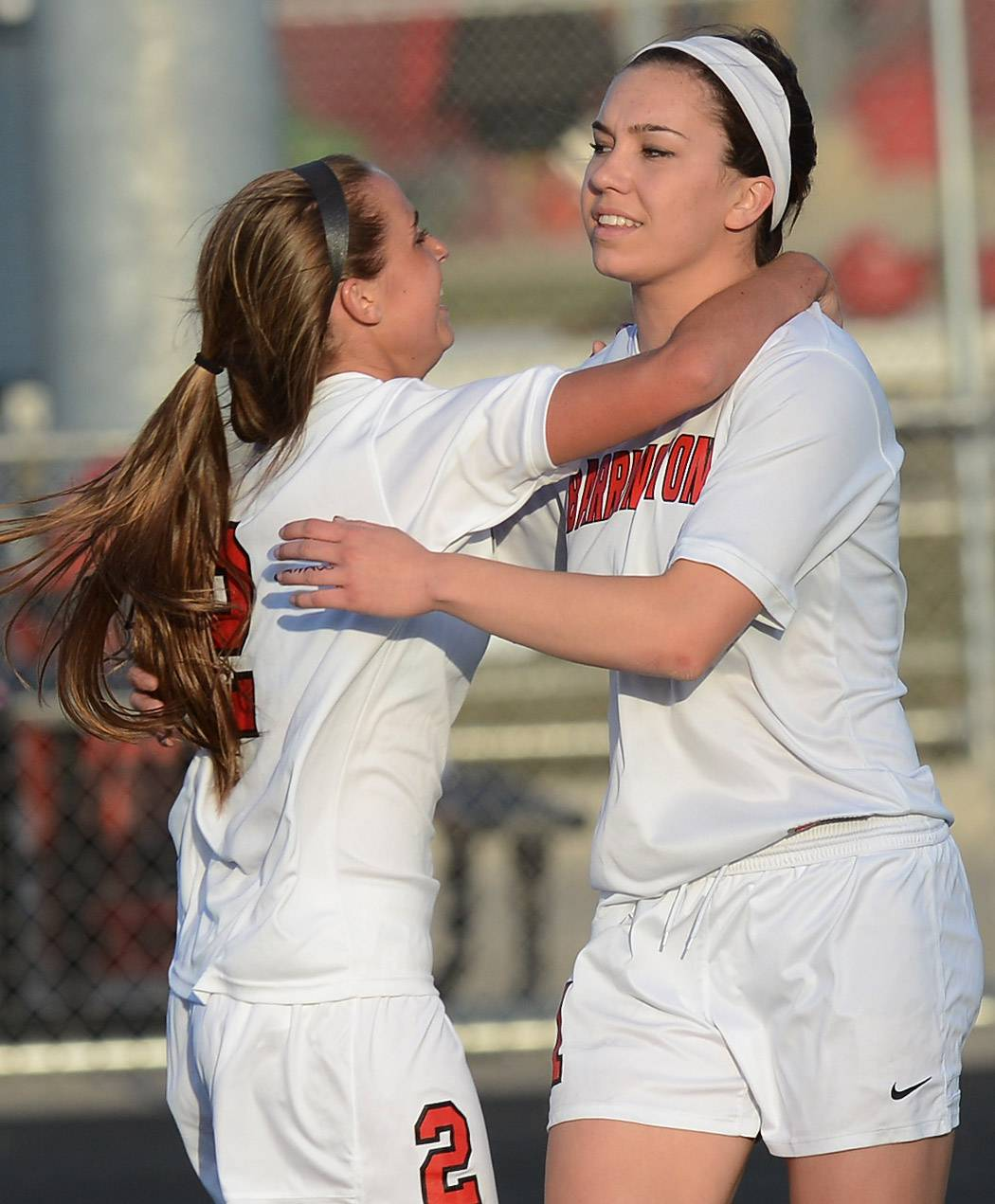 Barrington's Annalise Avers, left, congratulates teammate Jenna Szczesny after her first-half goal during Wednesday's game against Fremd.