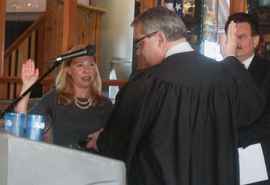 Circuit Court Judge John G. Dolton swears in Anna Moeller as a member of the state legislature last year.