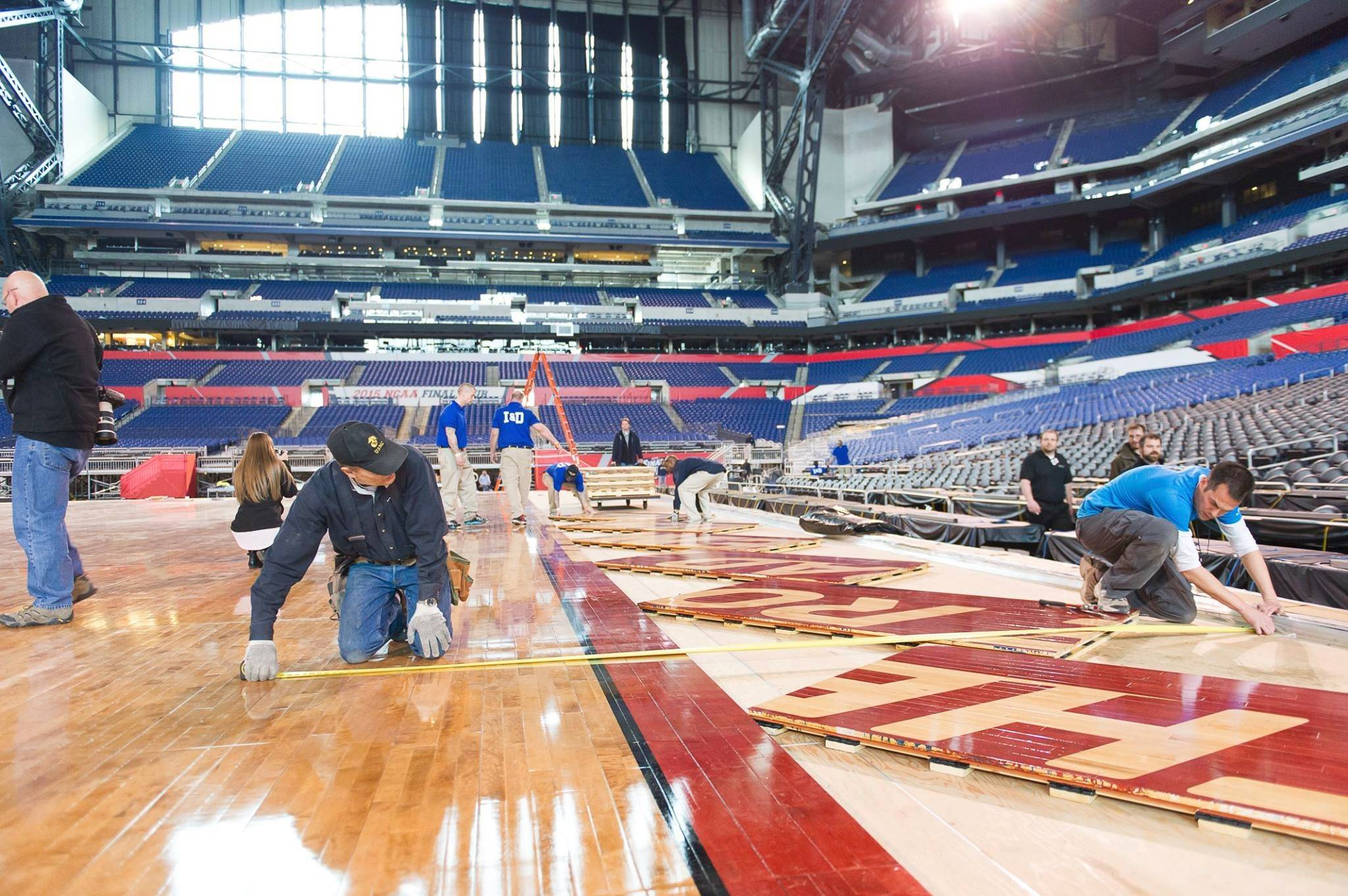 Andrew Campbell and Bruce Haroldson of Connor Sports helped install the basketball court on which the Final Four will be played in Indianapolis.