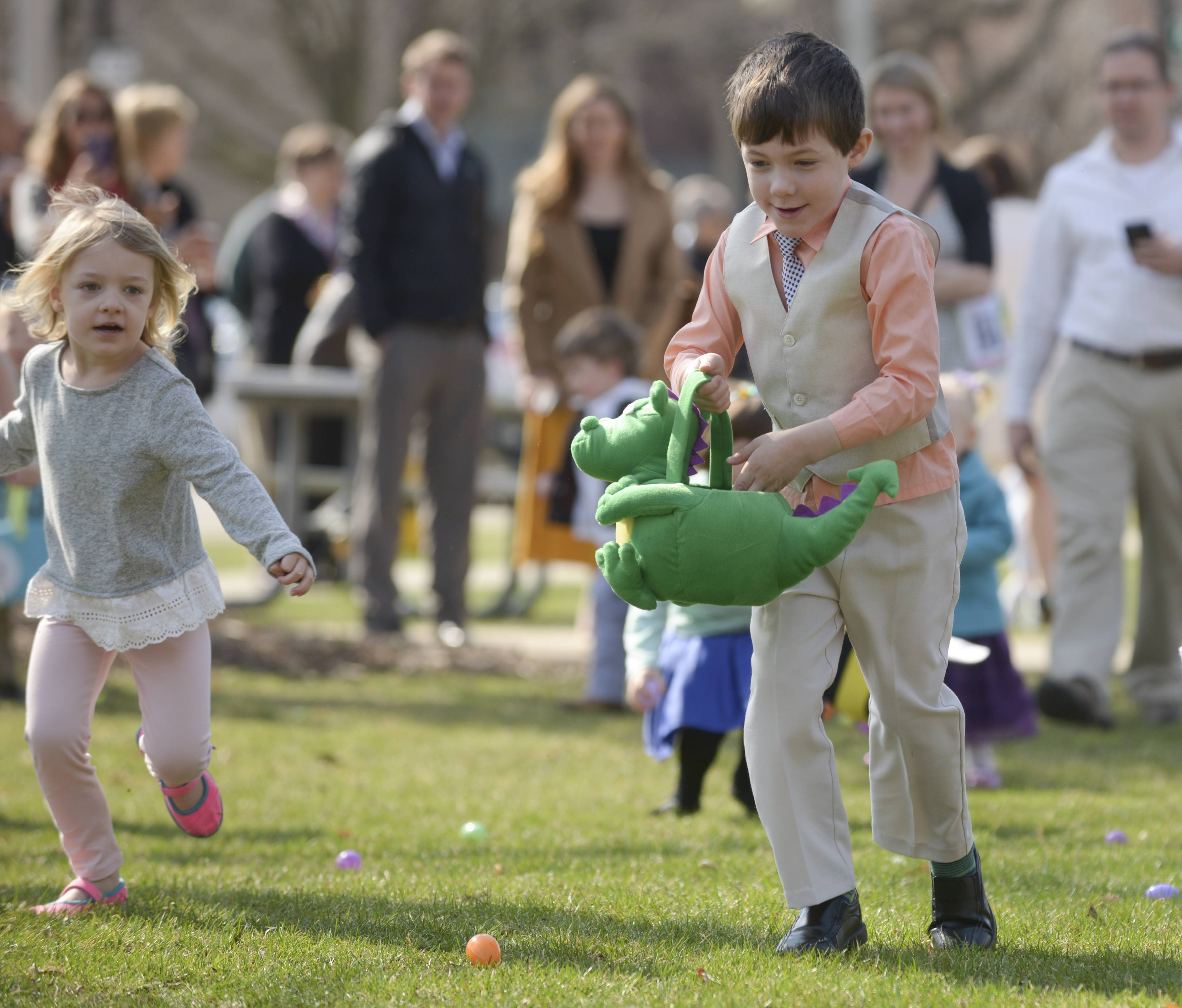 Ian Ruhter, 6, right of Wheaton gathers up the Easter eggs during the annual Gary United Methodist Church's Easter egg hunt at Memorial Park in Wheaton Sunday morning.