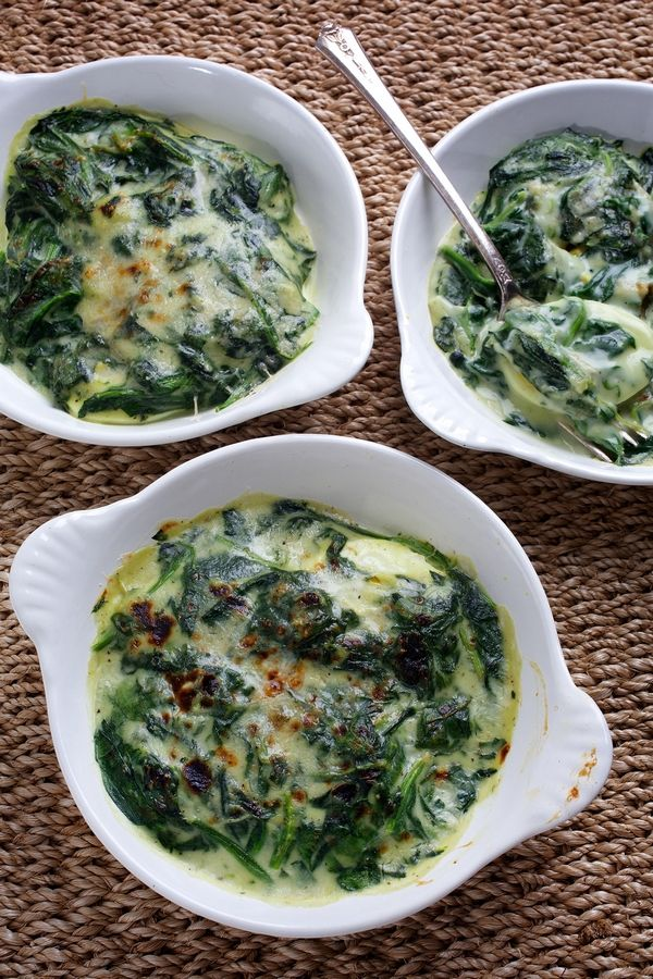 You can simplify the recipe for Spinach with Bechamel and Eggs by buying hard-cooked eggs. Serve with crusty bread for scooping.