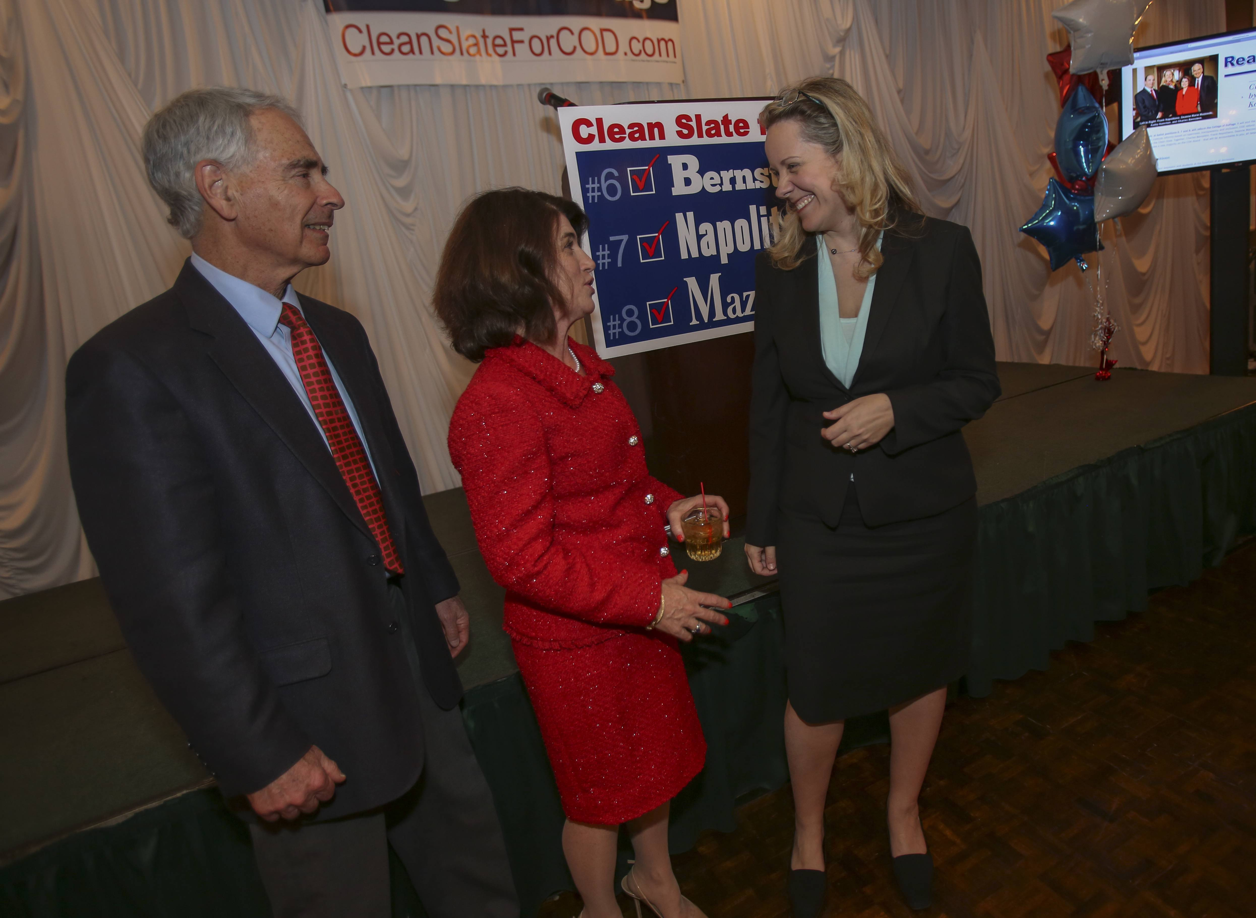 Charles Bernstein, left, and Deanne Mazzochi, right, celebrate their victory Tuesday with Kathy Hamilton, who endorsed their Clean Slate candidacy for the College of DuPage board.