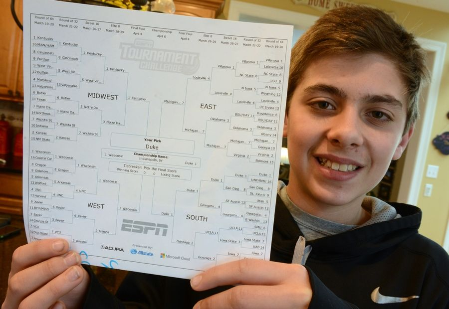 Lake Zurich Middle School North sixth grade student Sam Holtz shows off his ESPN NCAA men's basketball tournament bracket where he picked Duke to defeat Wisconsin in the finals.
