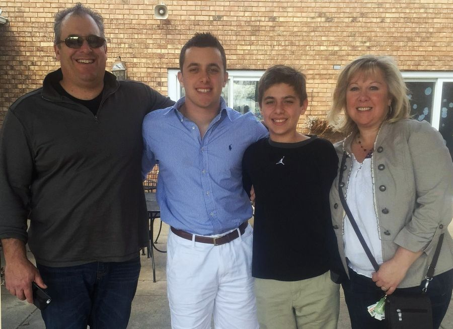The Holtz family of Hawthorn Woods from left Butch, Joey, Sam and Liz are getting some media attention after Sam's ESPN NCAA men's basketball tournament bracket picks.