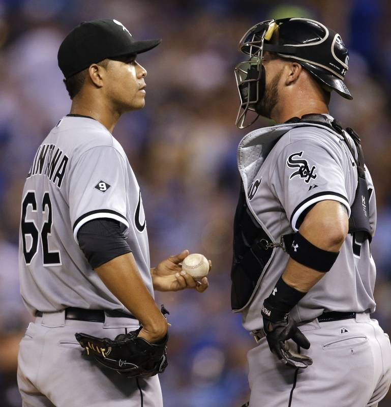 Imageswhite sox fall to royals 7 5 chicago white sox starting pitcher jose quintana talks with catcher tyler flowers right during mightylinksfo Choice Image