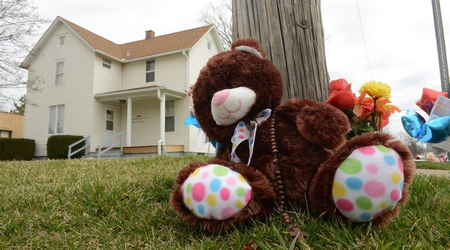 A teddy bear is part of a memorial for Justus Howell, 17, of Waukegan who was shot April 4 by a Zion police offer near the intersection of Galilee Avenue and 24th Street.