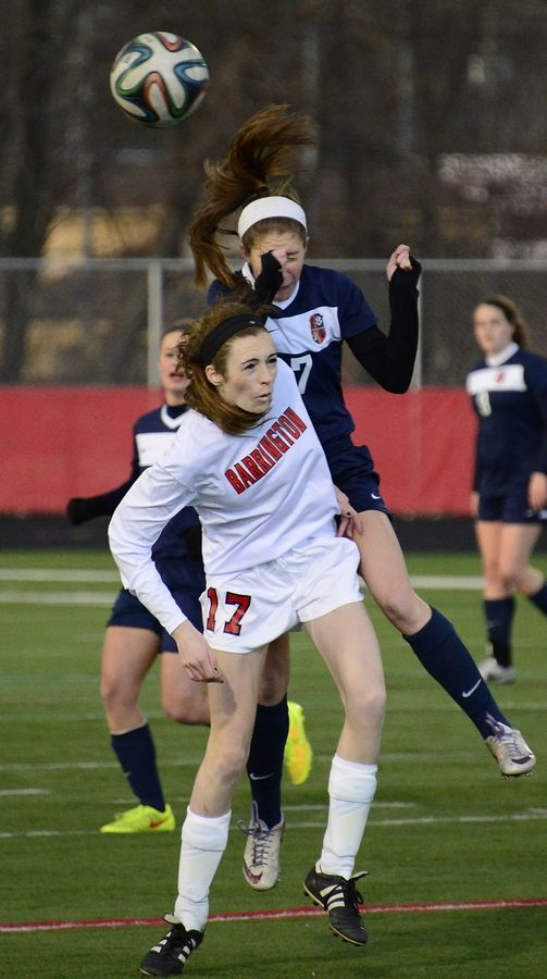 Barrington's Soph Spinell and Conant's Leah Celarek collide as they struggle to gain control of the ball in the first half at Barrington on Friday.