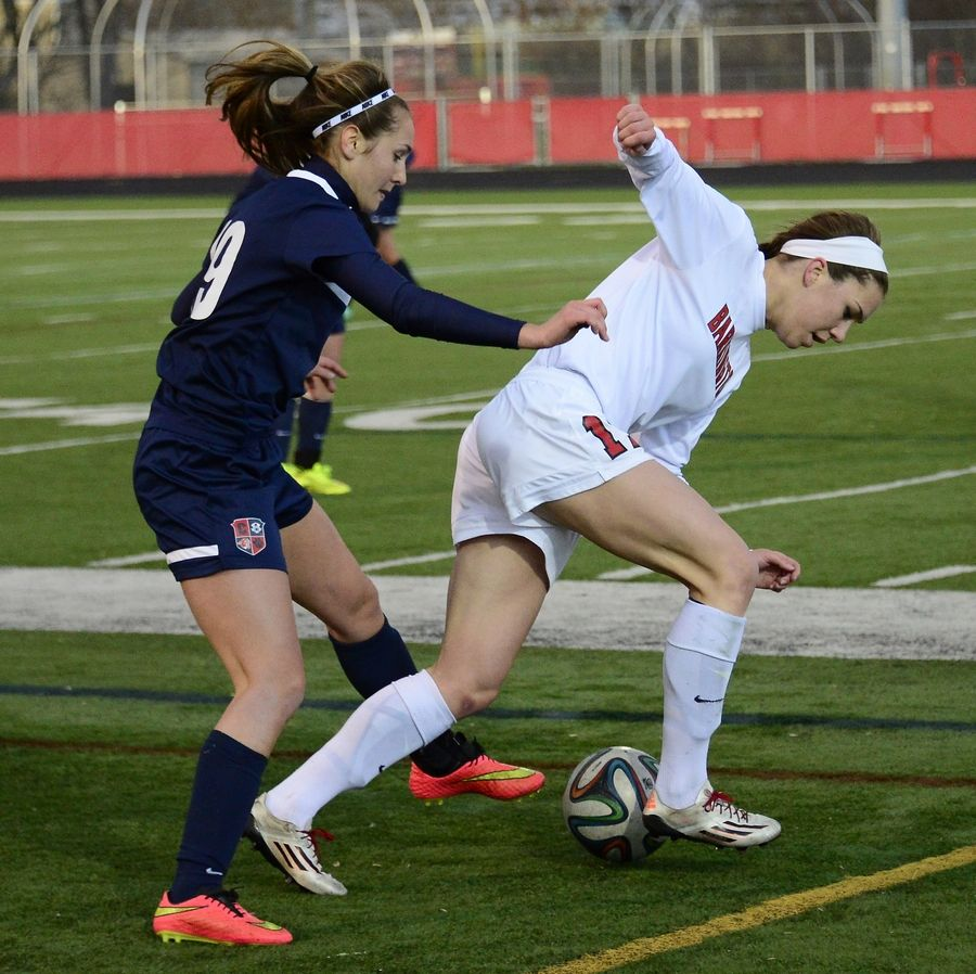 Barrington's Jenna Szczesny gets tripped up by Conant's Rachel Raymer while trying to gain control of a possession at Barrington on Friday.