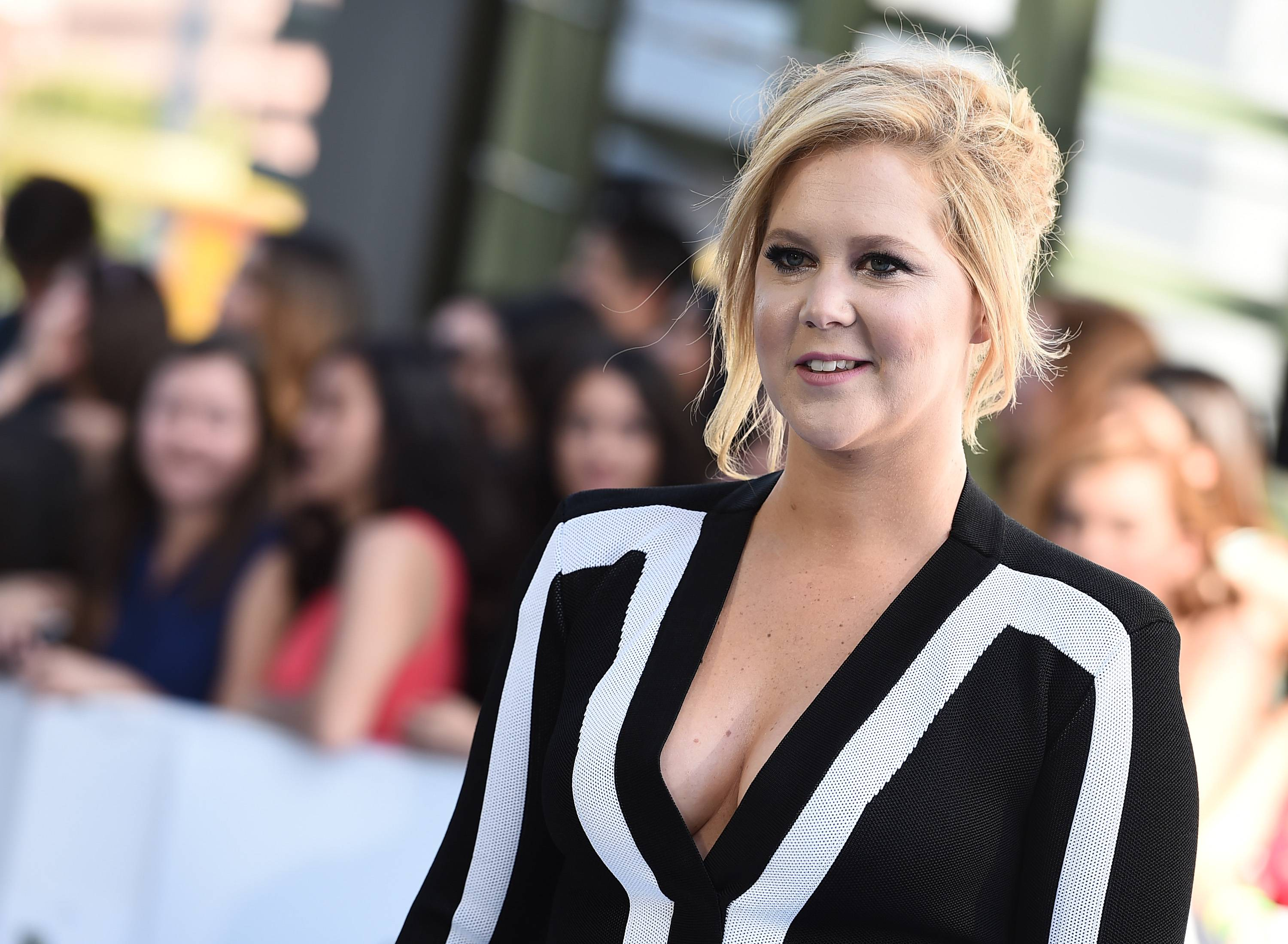 Host Amy Schumer arrives at the MTV Movie Awards at the Nokia Theatre on Sunday in Los Angeles.