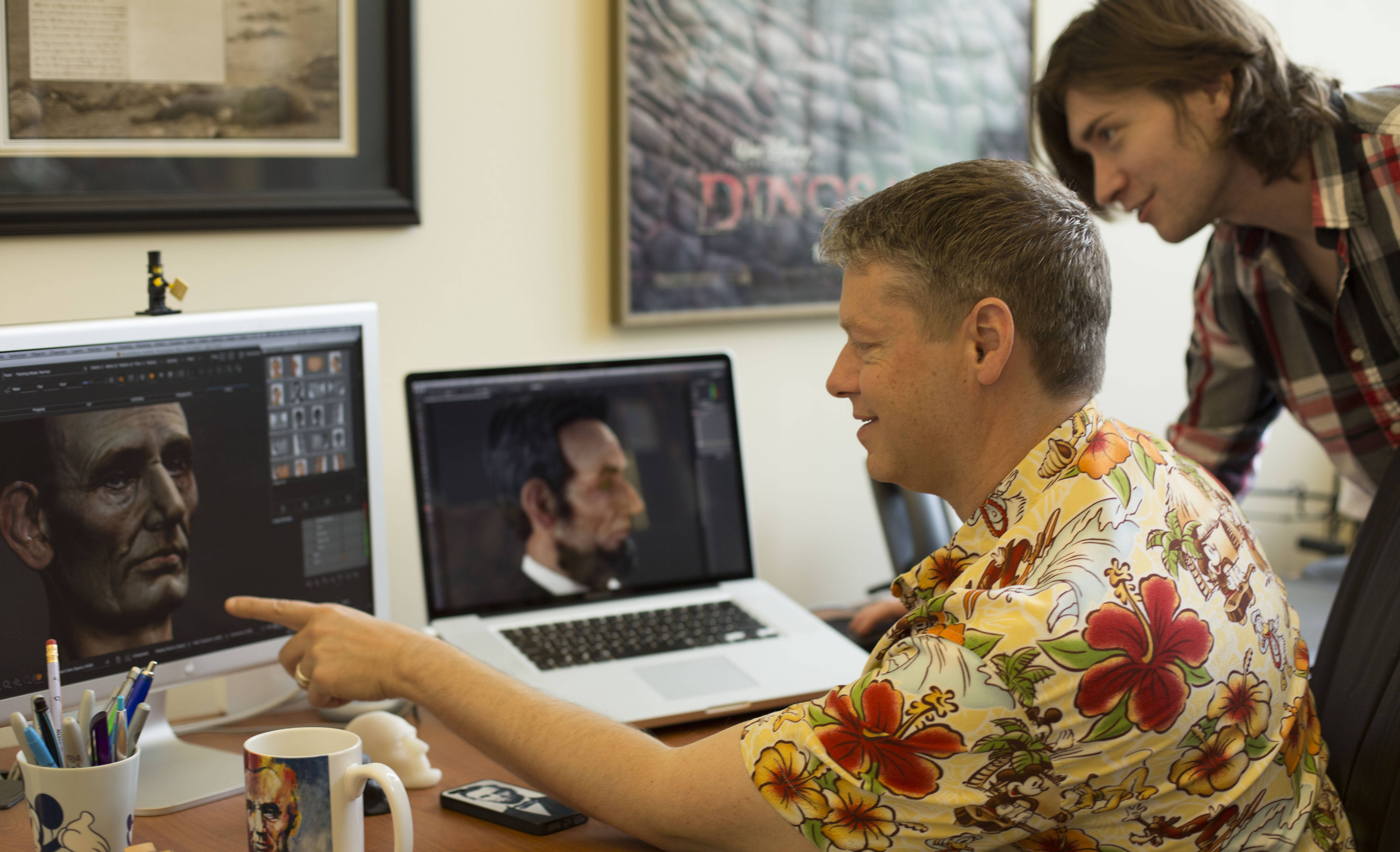 "Using modern software to apply and adjust the textures in Abraham Lincoln's face, professor and animator Christopher Oakley, sitting, shows the University of North Carolina Asheville's ""Virtual Lincoln"" to New Media lecturer Adam Bryant, producer of the ambitious project. The end result will be a lifelike animated movie of the 16th president delivering his Gettysburg Address."