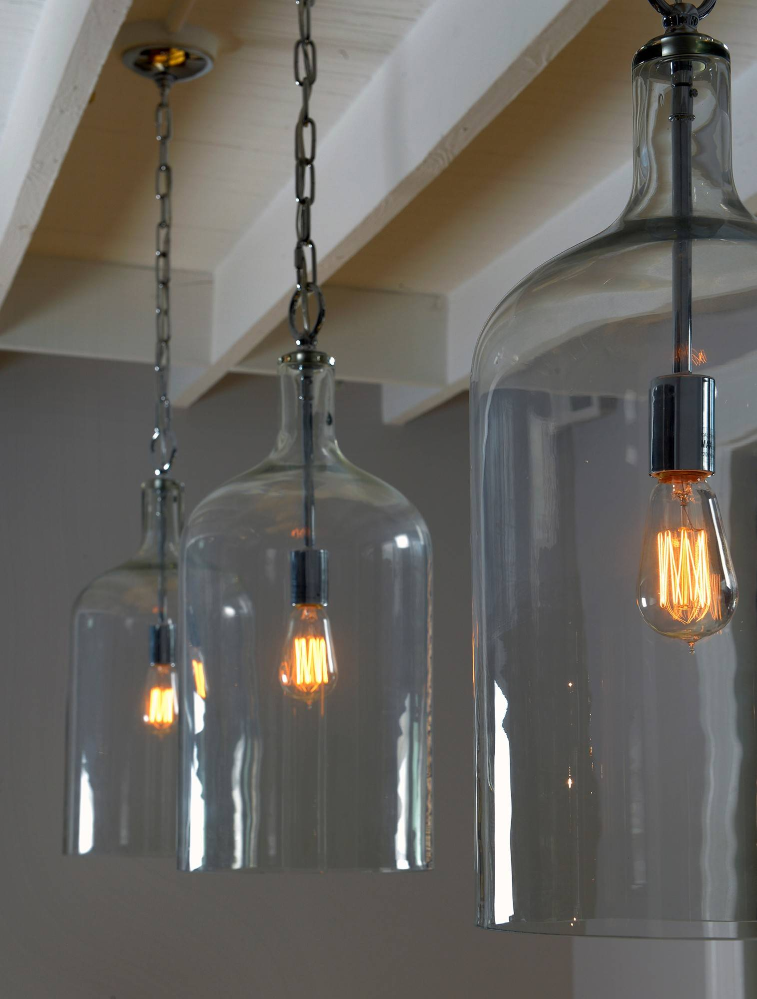 These Glass Jug Pendant Lights From Shades Of Light Add An Industrial Note  To The Dining