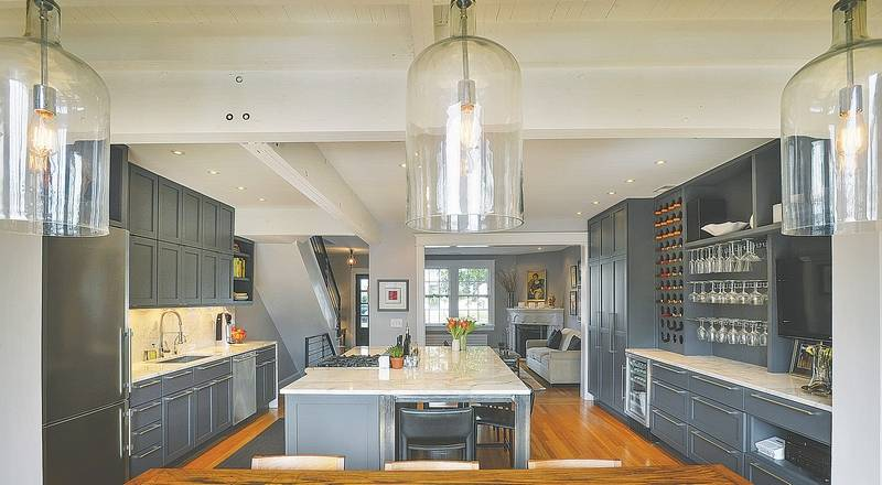 Removing walls in a 1923 house allows light to flood in for Kitchen designs with lots of windows