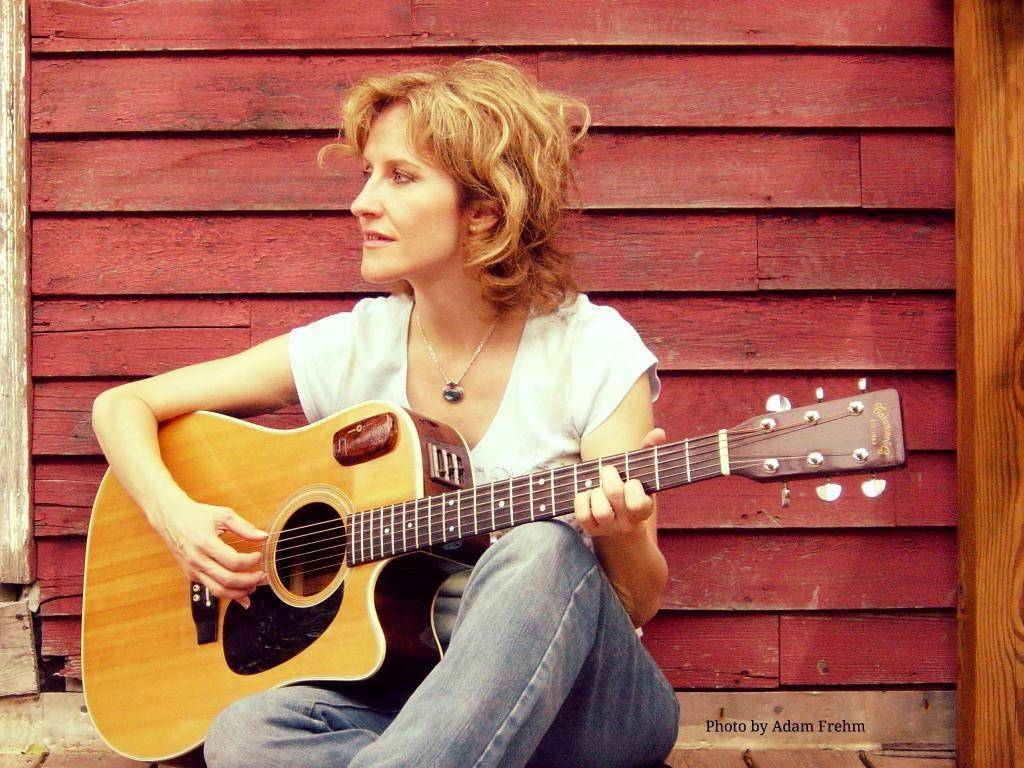 Folk singer and songwriter Sally Barris performs at the Maple Street Chapel in Lombard.