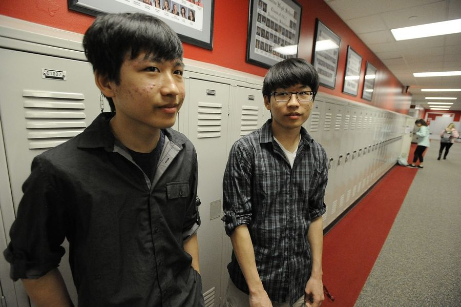 Twin brothers Kyle, left, and Ryan Jannak-Huang both earned perfect scores of 36 on the ACT. The Palatine High School students credit their success on the college entrance exam to years of practice and the motivation and support they provide one another.