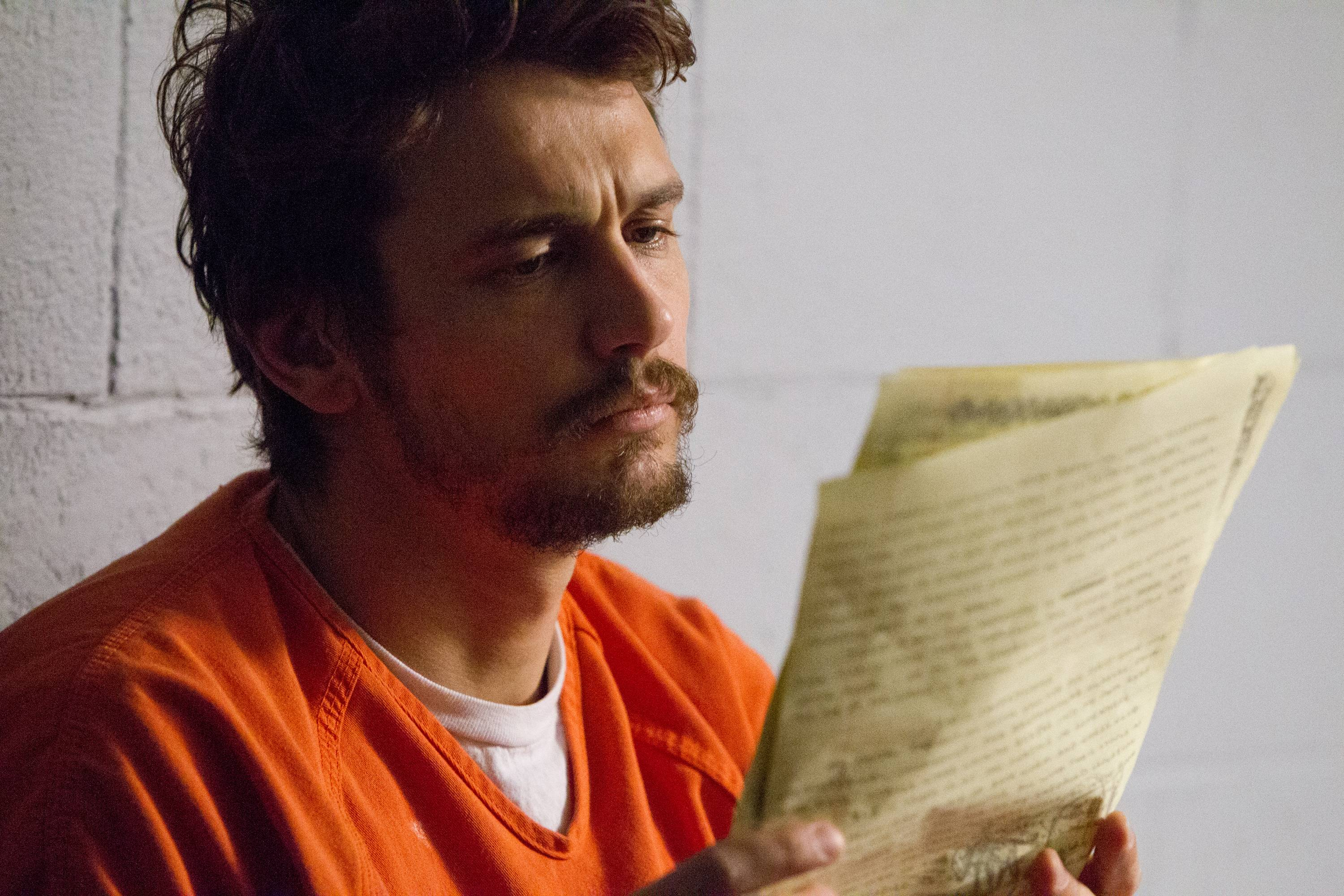 "Christian Longo (James Franco) faces trial for killing his family in ""True Story."""