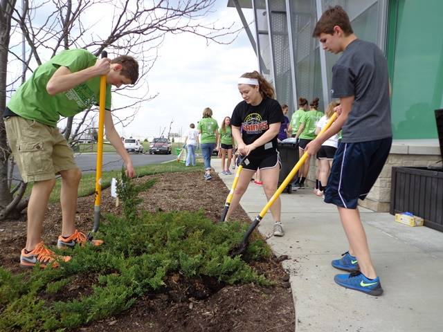 St. Charles East students participated in Global Youth Service Day on Friday by preparing garden beds at Northern Illinois Food Bank's West Suburban Center in Geneva.