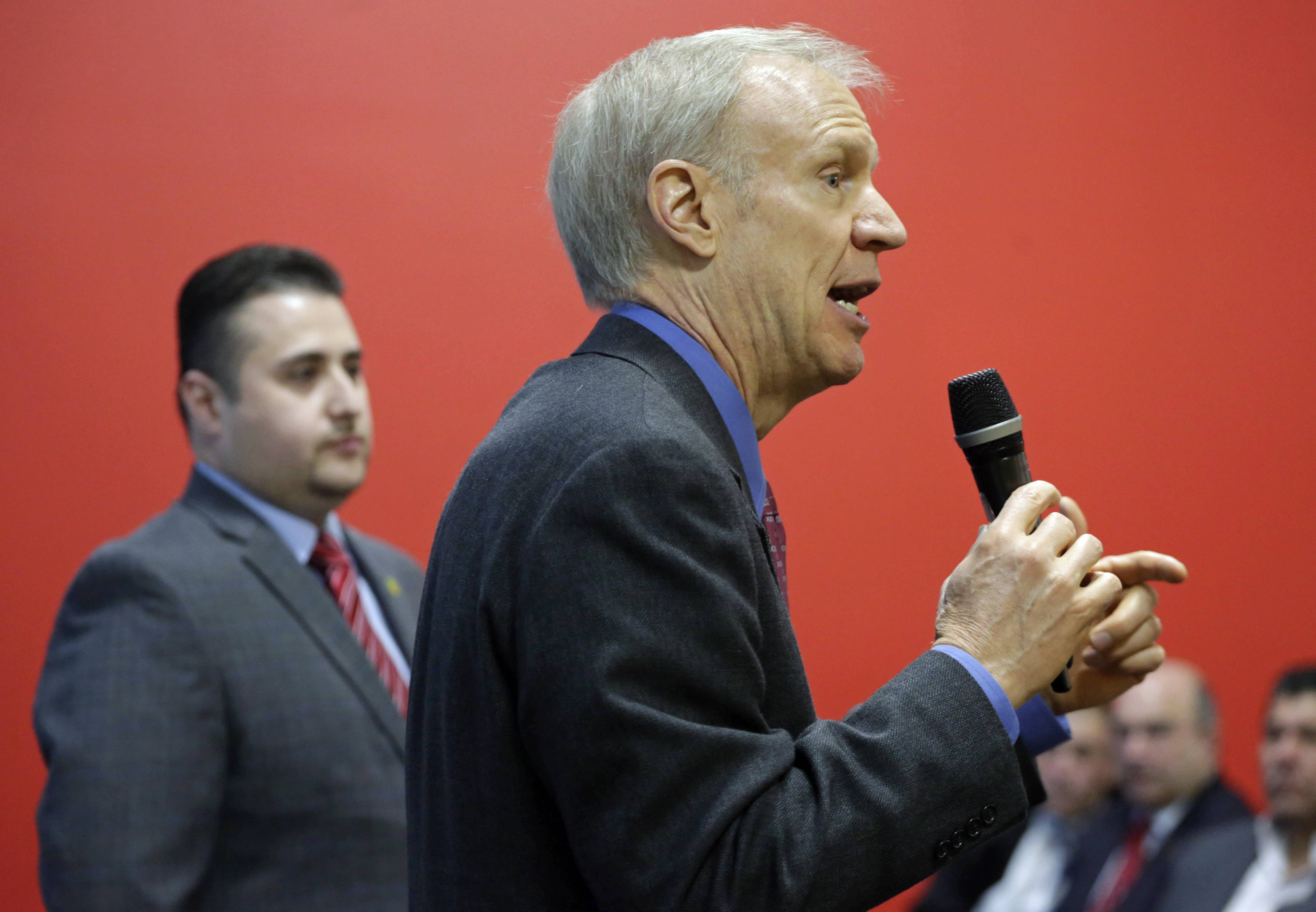 Illinois Republican Gov. Bruce Rauner speaks to business leaders in the Little Village neighborhood of Chicago. Rauner is trying to broker a master deal in the Legislature to advance some of his pro-business priorities in exchange for new revenue to save programs near and dear to Democrats.
