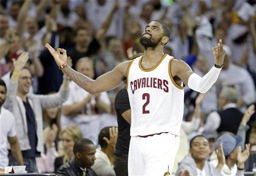 Cleveland Cavaliers' Kyrie Irving celebrates after making a 3-point shot at the buzzer to end the second quarter of a first round NBA playoff basketball game against the Cleveland Cavaliers Sunday, April 19, 2015, in Cleveland. (AP Photo/Mark Duncan)