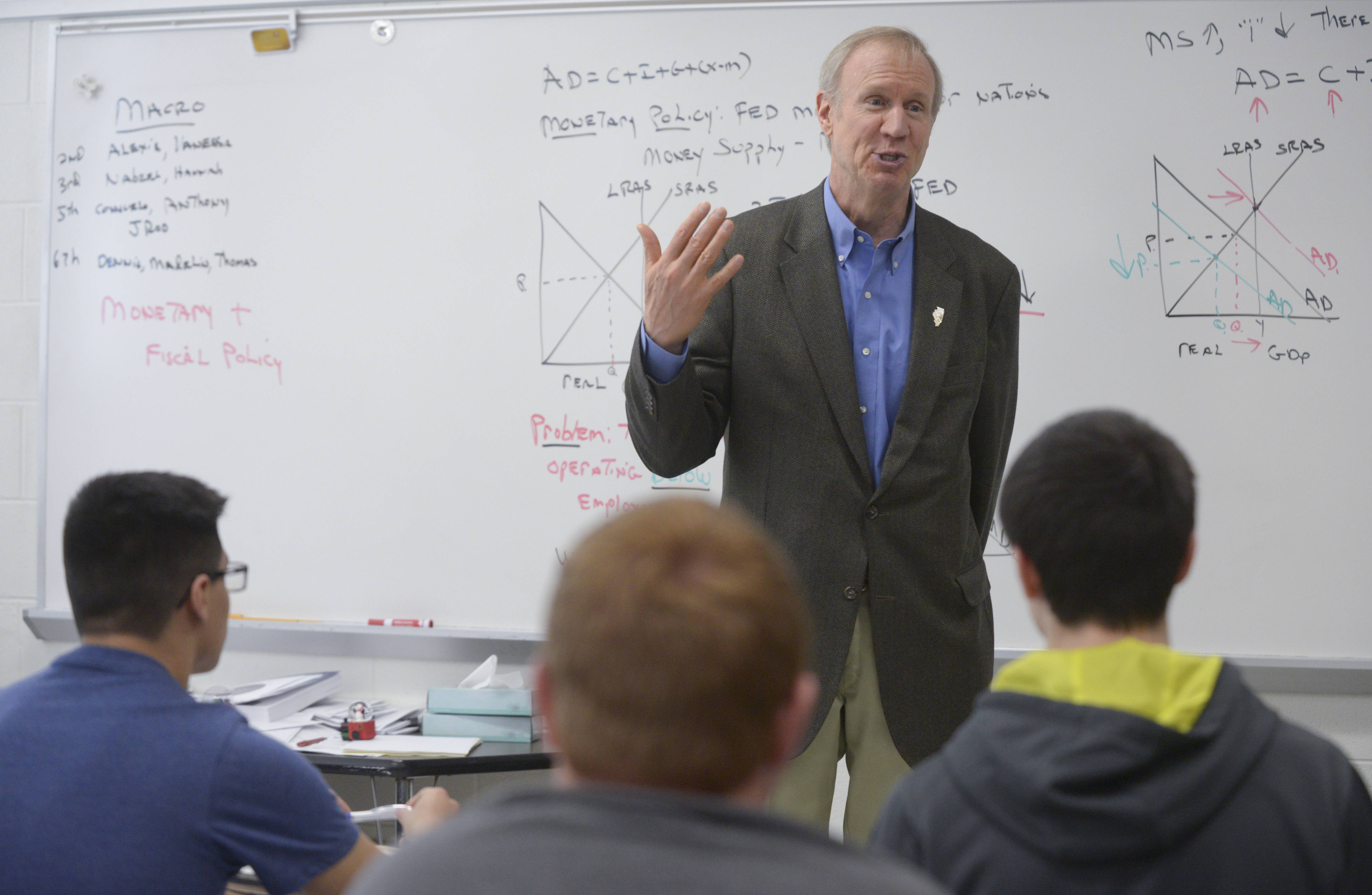 Gov. Bruce Rauner visits an economics class during his visit to Addison Trail High School while on his Illinois Turnaround tour.