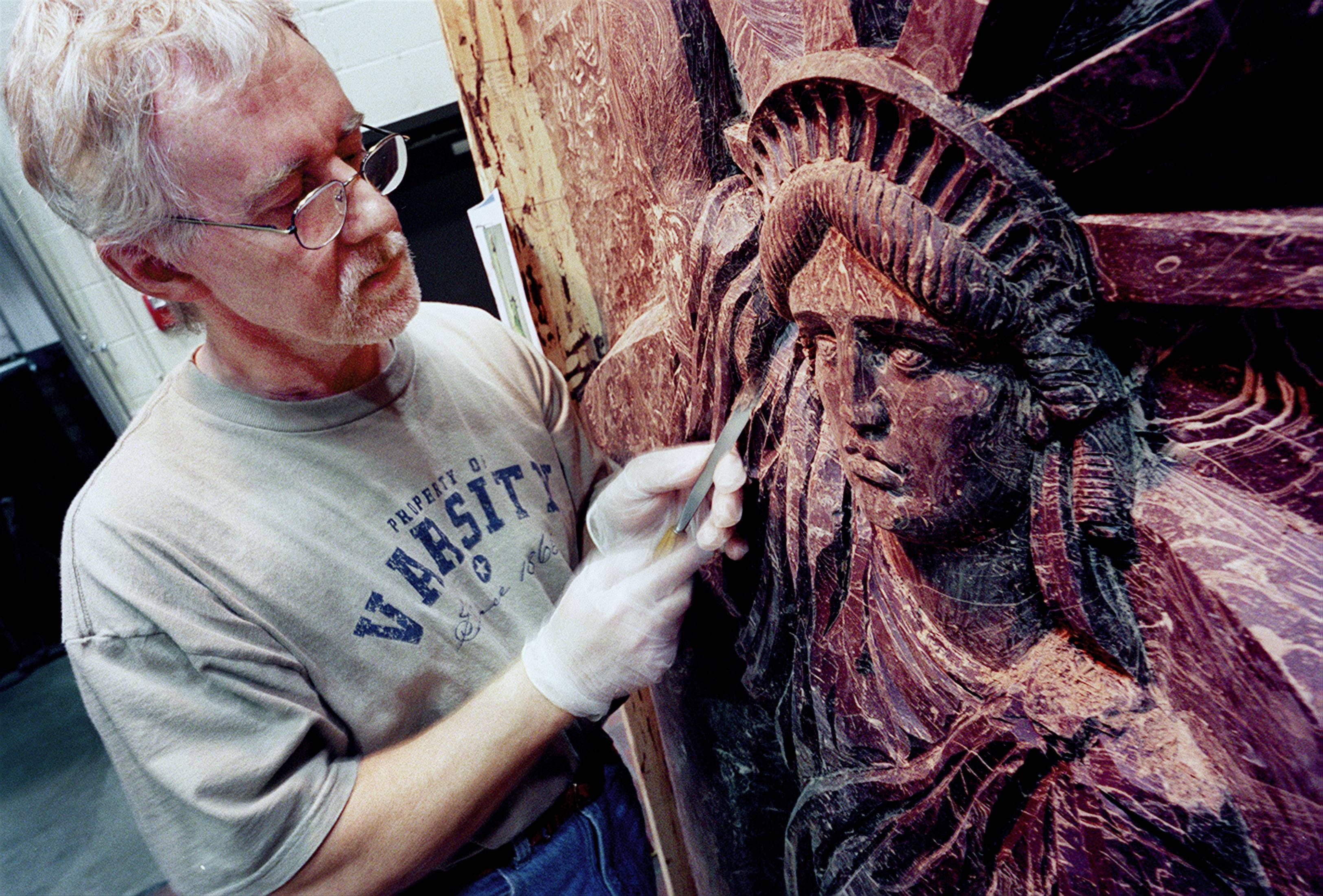 Sculptor Jan Wakulinski of Wheeling works a wood chisel on the 9-foot-tall-by-5-foot-wide chocolate panel of the Statue of Liberty that was featured in the Long Grove Chocolate Fest in 2002.