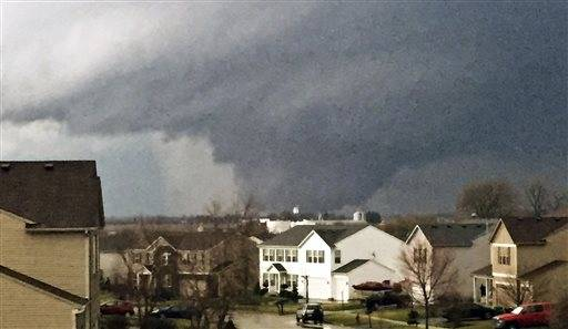 In this photo provided by Emily Mains, a tornado is viewed near Pearl Street from a home in the Kennedy's subdivision in Kirkland, Ill., on Thursday, April 9, 2015. One person was killed in the tiny community of Fairdale, James Joseph with the Illinois Department of Emergency Management said.