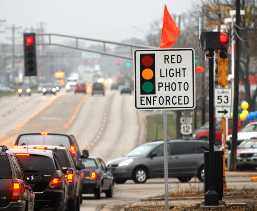 A state proposal could ban red-light cameras in smaller suburbs.