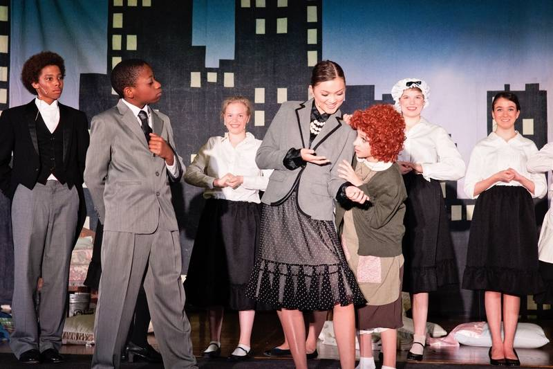 From left, Jeremiah Staten as Oliver Warbucks, Jasmine Vanderbilt as Grace  Farrell, and