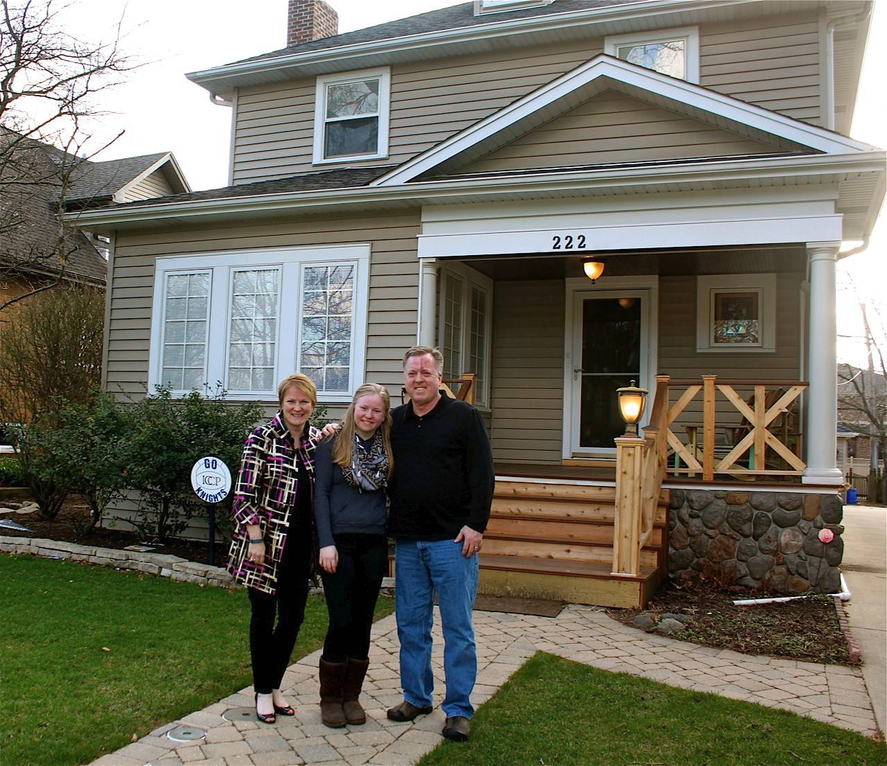 Amy and Tom Fahey, shown in front of their Elmhurst home with daughter Molly, have made plans to build a second house they can enjoy before retirement.