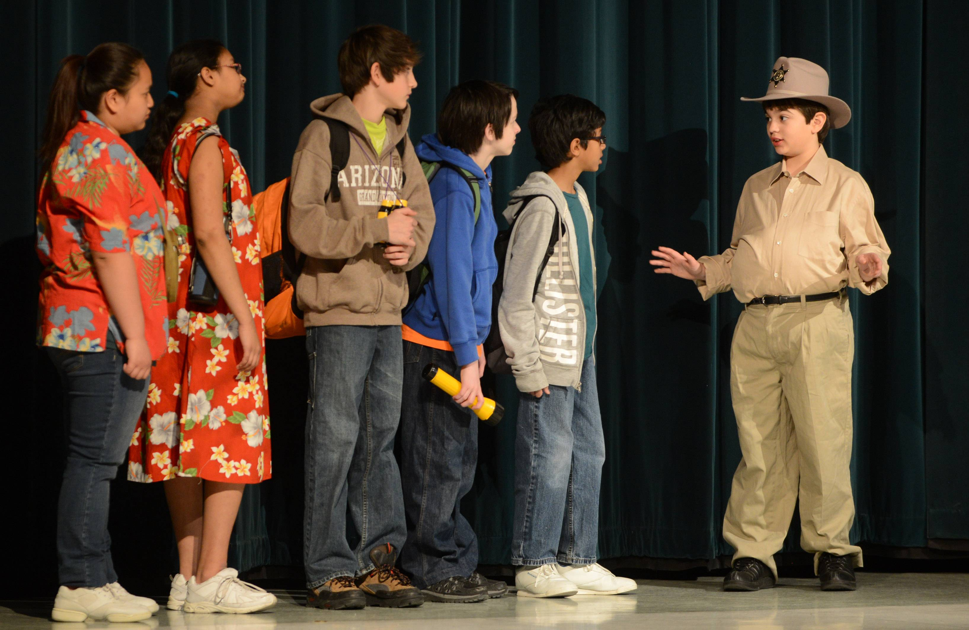 "Jacob Adrian, right, plays the sheriff, giving some ground rules to a group of UFO seekers, during Woodland Middle School Drama Club's Thursday dress rehearsal for ""The Aliens are Coming! The Aliens are Coming!"" The play is being performed at the Gurnee school Friday and Saturday night."