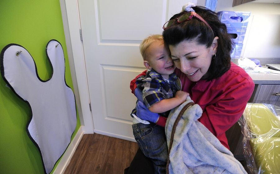 Dr. Victoria A. Ursitti gives Teddy Jedlowski, 2, of Schaumburg a hug after his dental appointment.
