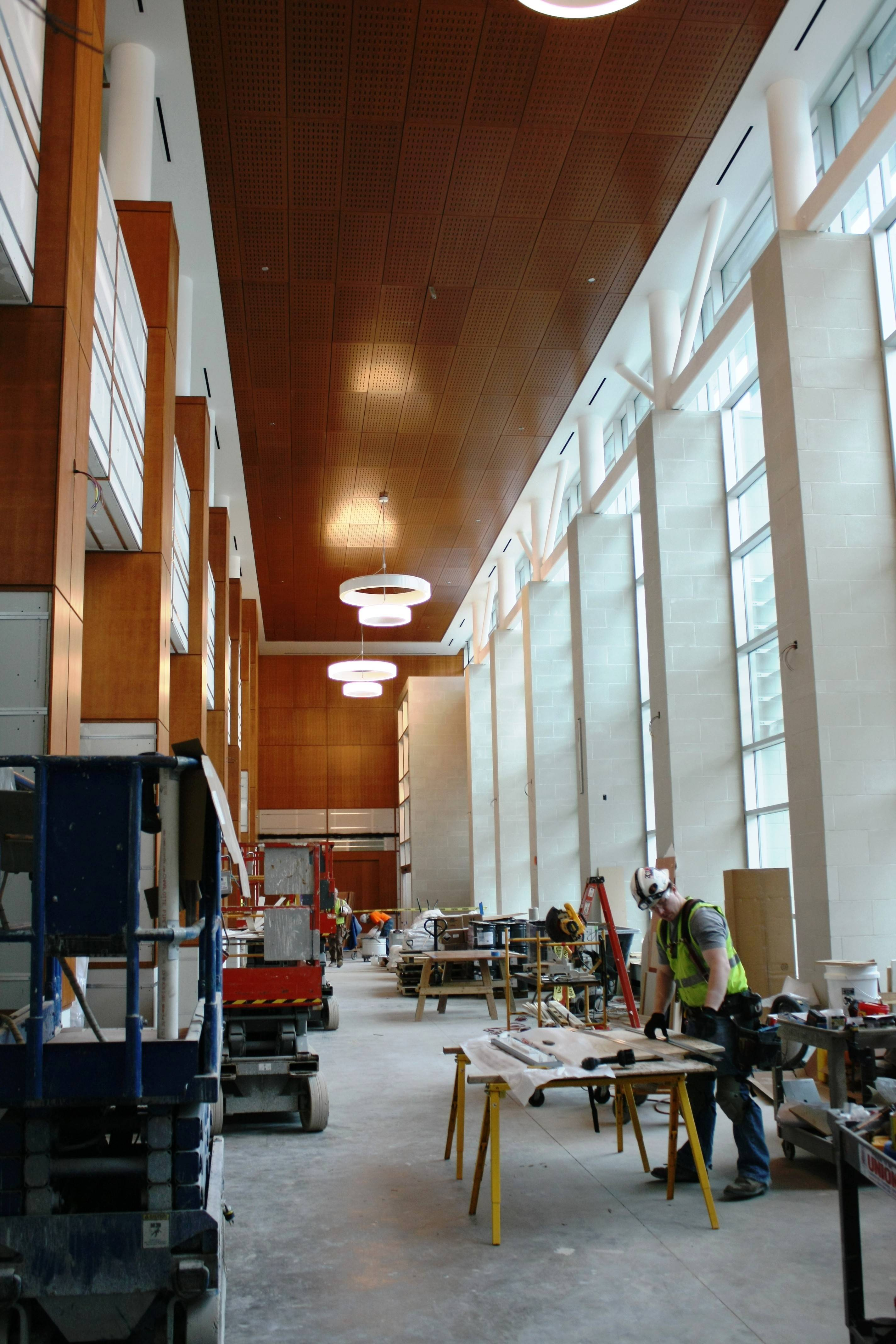 Workers continue putting the finishing touches on the lobby of Aurora's new Richard and Gina Santori Public Library in downtown.