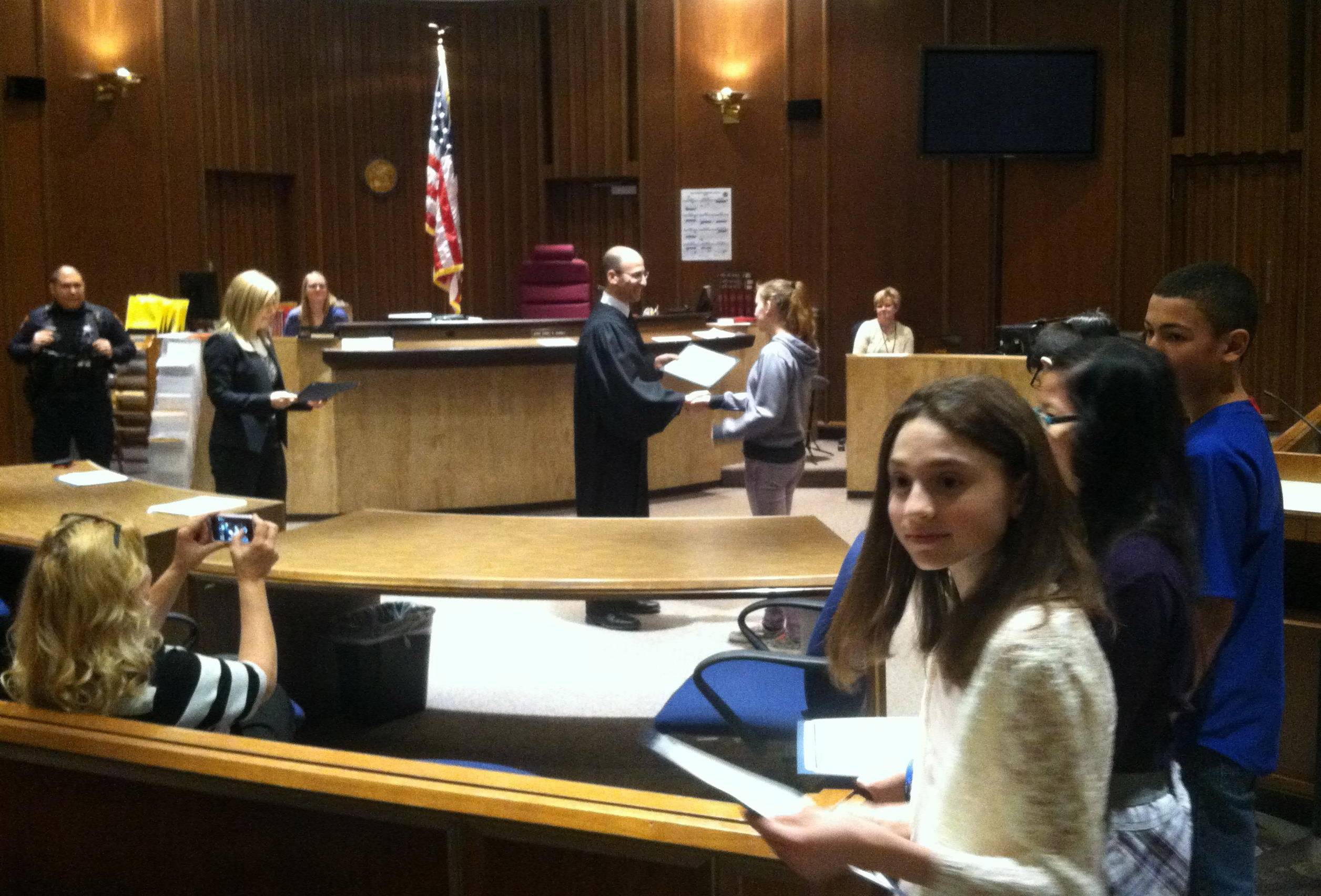 Lake County Judge Daniel Shanes hands out awards to Mundelein-area middle school students during an achievement ceremony Friday at the Lake County courthouse.
