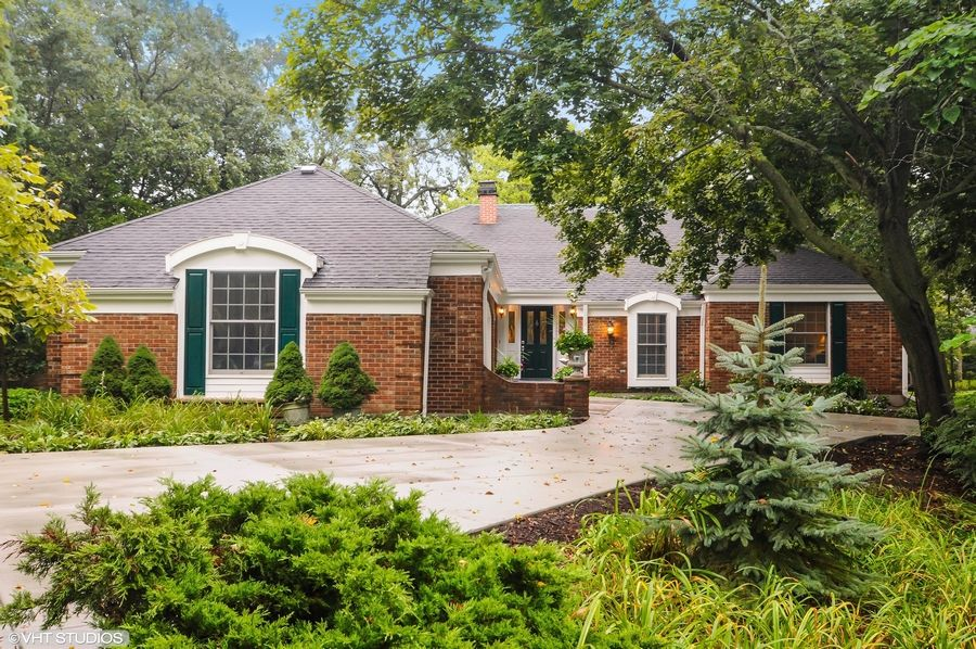 This brick ranch home with four bedrooms in North Barrington is on a lot with many large trees.