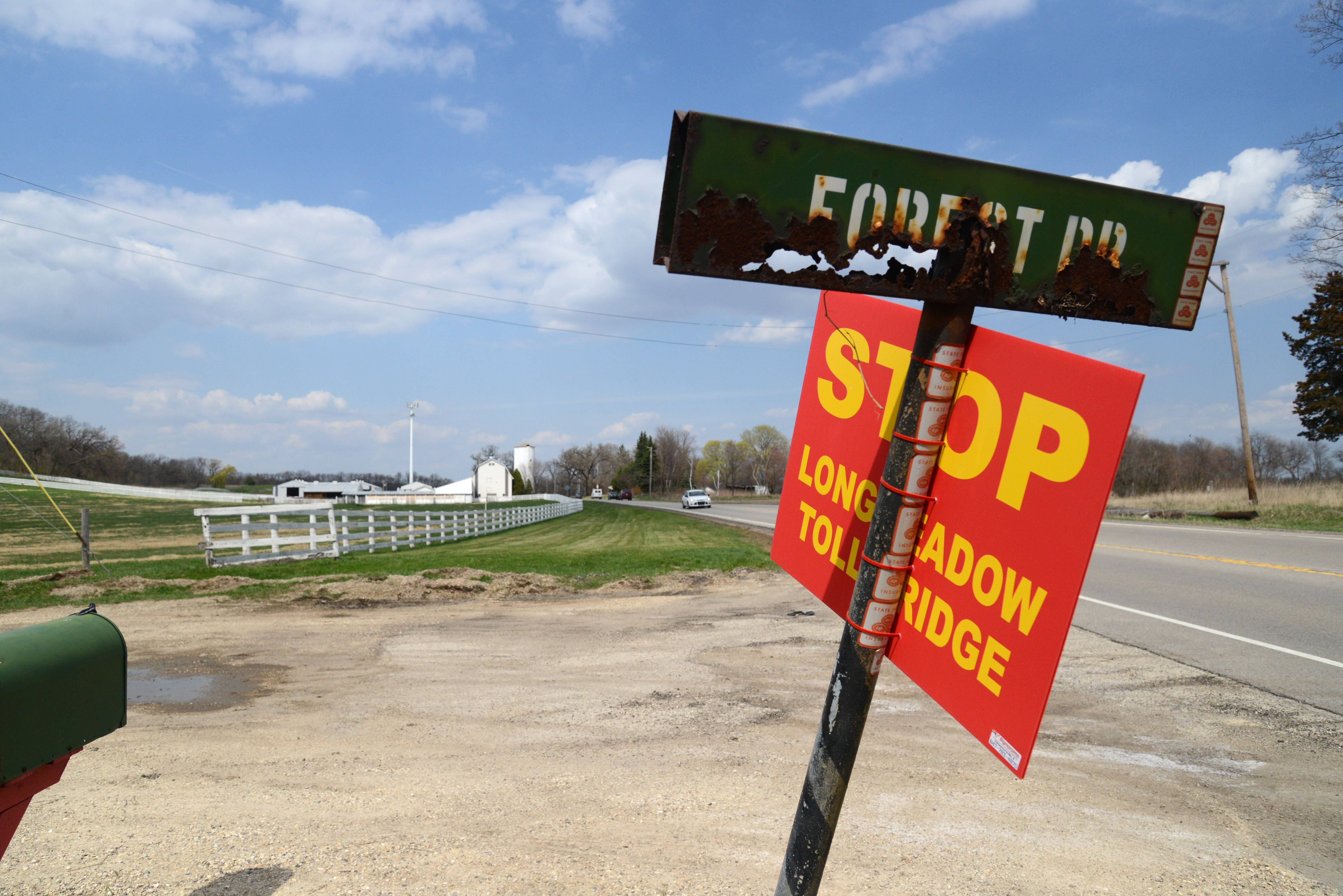 Signs along Route 31 at Forest Road show opposition against the Longmeadow Parkway. The toll road would cut west across this farm property on Route 31 in Carpentersville.