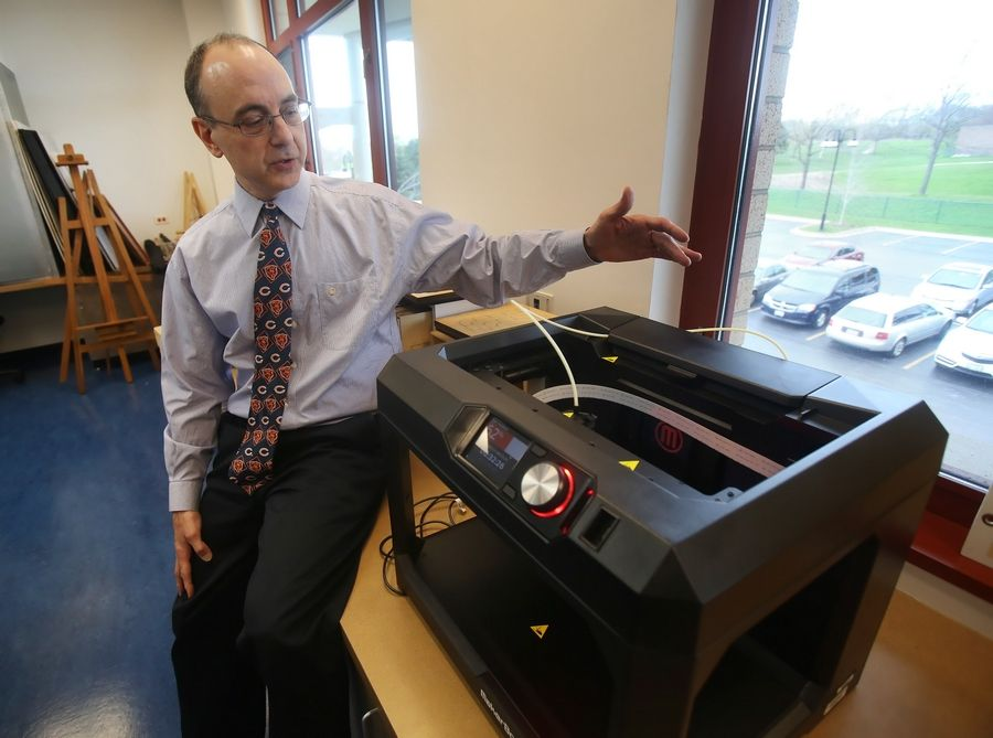 Fremont library Director Scott Davis describes the new MakerBot Replicator Desktop 3-D printer the library acquired last fall.