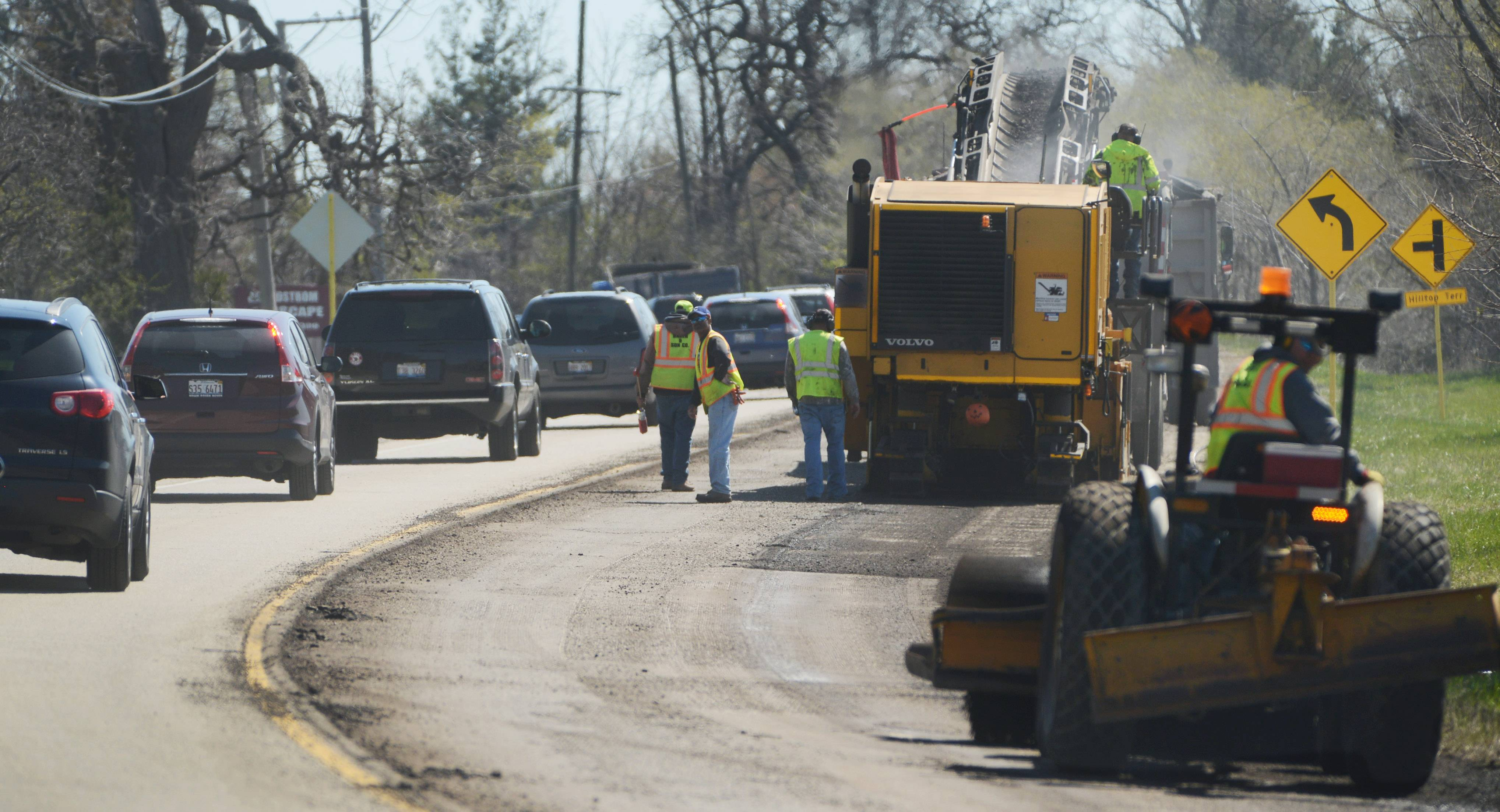 Traffic was reduced to one lane along Route 176 east of Gilmer Road near Mundelein on Tuesday as crews remove top layers of the roadway.