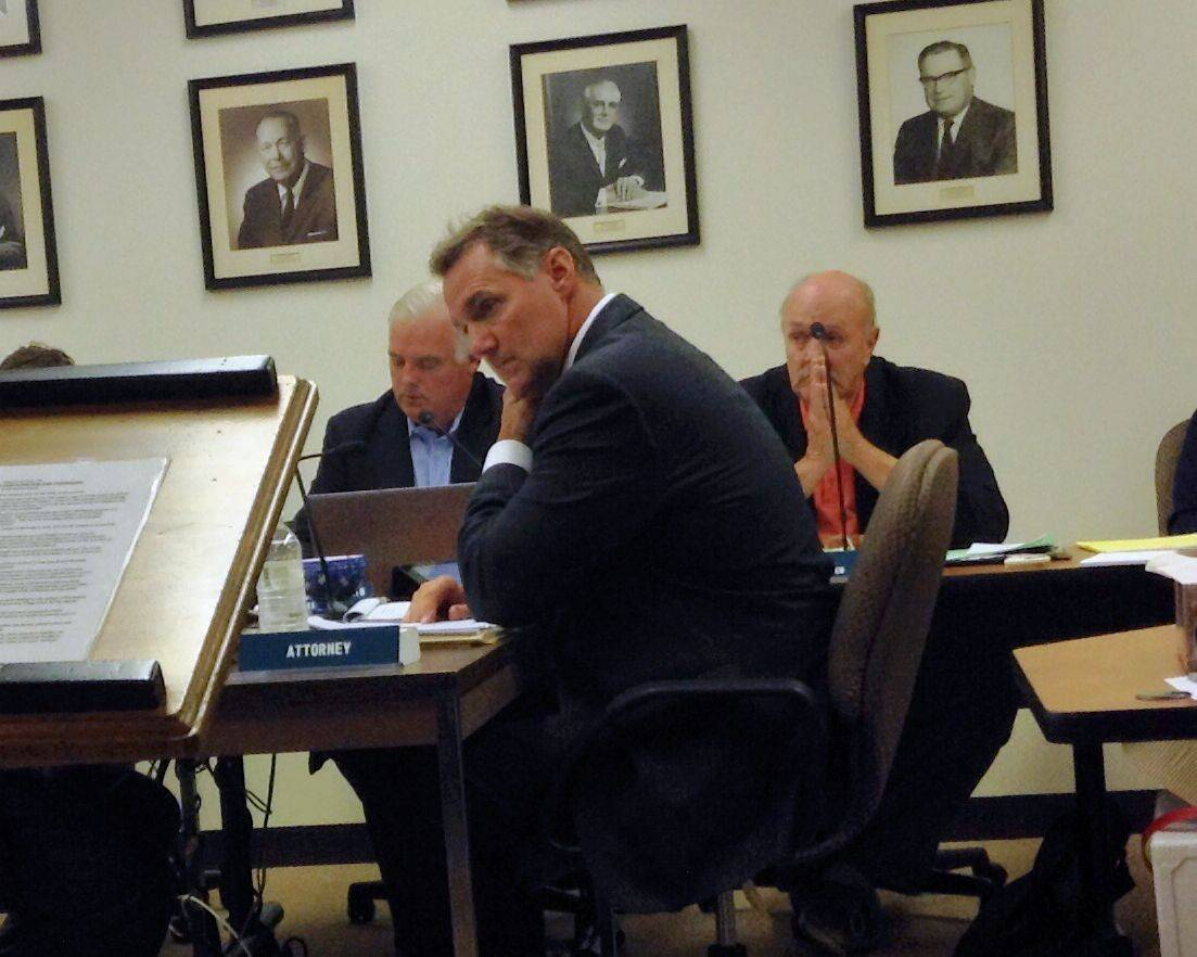 Patrick Bond, the temporary village attorney, listens during a September 2014 board meeting. Bond and Mary Dickson have acted as village attorney since their firm was appointed by Village President Martin McLaughlin last August.