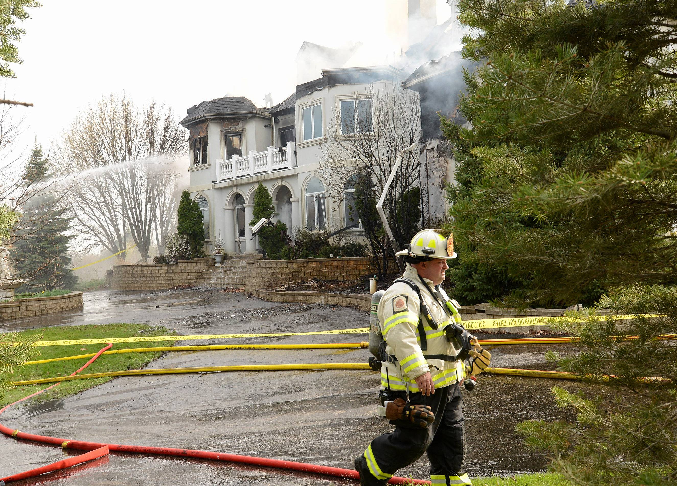 The massive fire that engulfed a Barrington Hills mansion April 18 served as a stark reminder of the challenges some suburban fire departments face when battling blazes in neighborhoods that lack hydrants or another easily accessible supply of water. More than a dozen tanker trucks from across the suburbs delivered water to the scene for four hours as firefighters worked to bring the blaze under control.