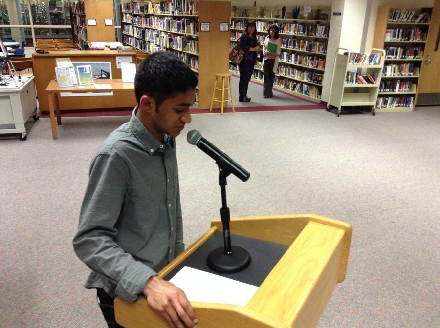 Warren sophomore Nikhil Patel asks the District 121 school board on Tuesday not to force him and four classmates to attend another school.
