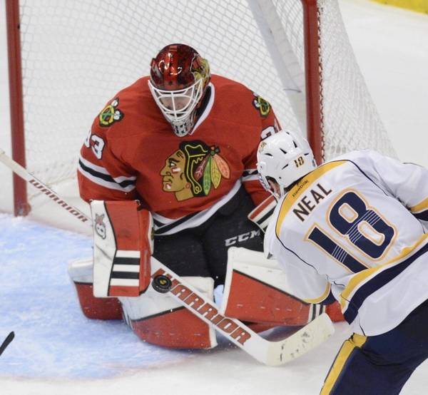 985421468 Blackhawks goalie Scott Darling stops a shot by Nashville Predators left  wing James Neal late in
