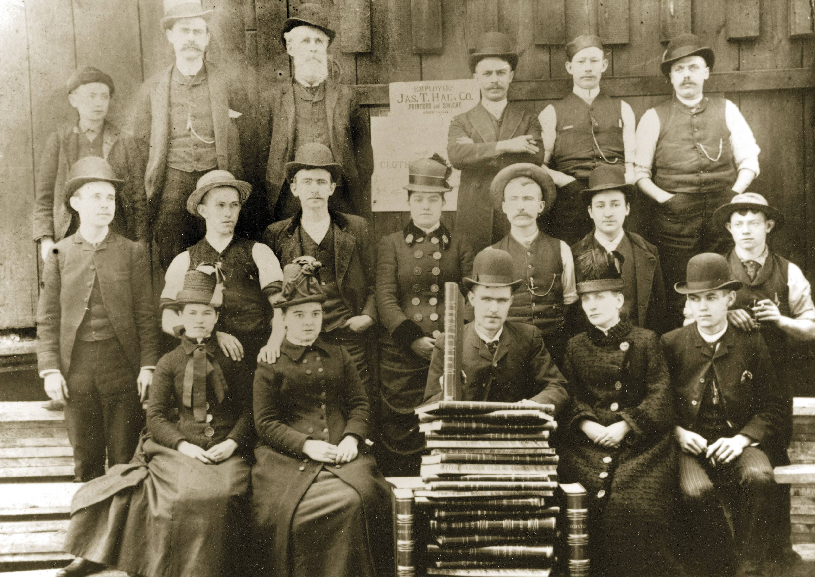 The original American Hotel staff, circa 1890, with owner, Thomas Leahy in the bowler hat in the center of the front row.