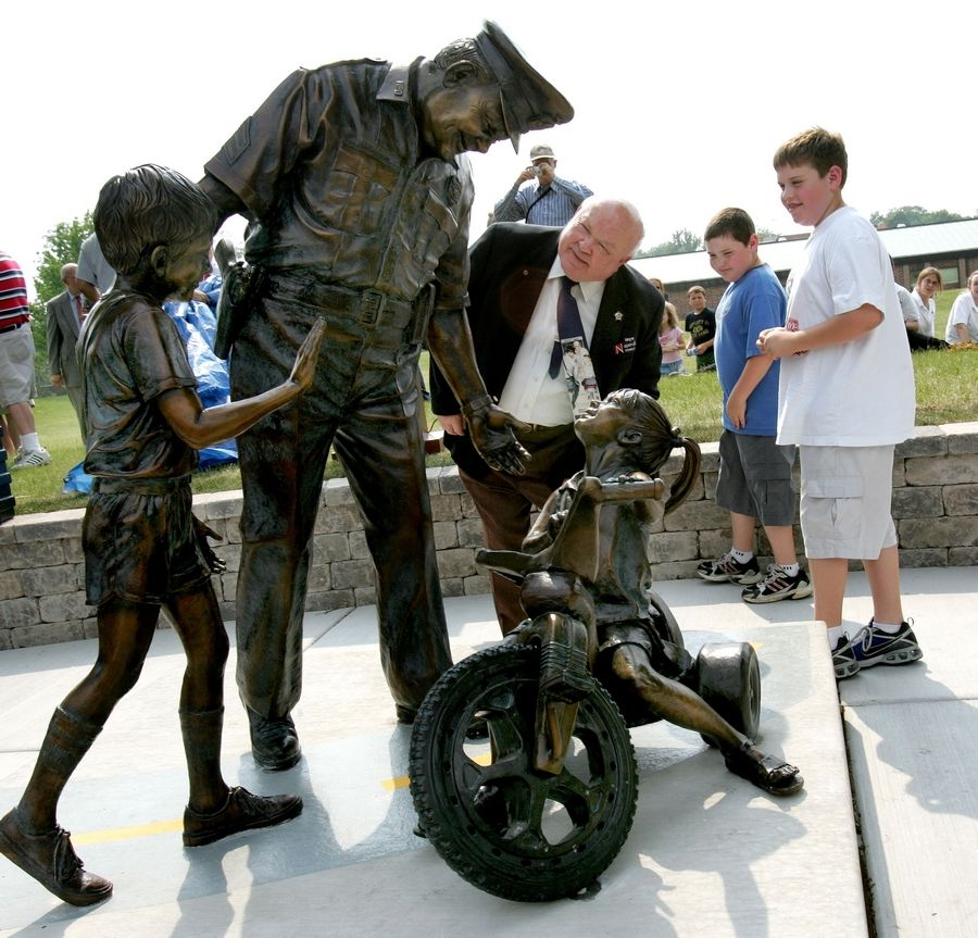 As Naperville's Officer Friendly and as the city's mayor, George Pradel's love for children has been clear. His dedication to Naperville children is immortalized in a sculpture on Washington Street near Washington Junior High School.